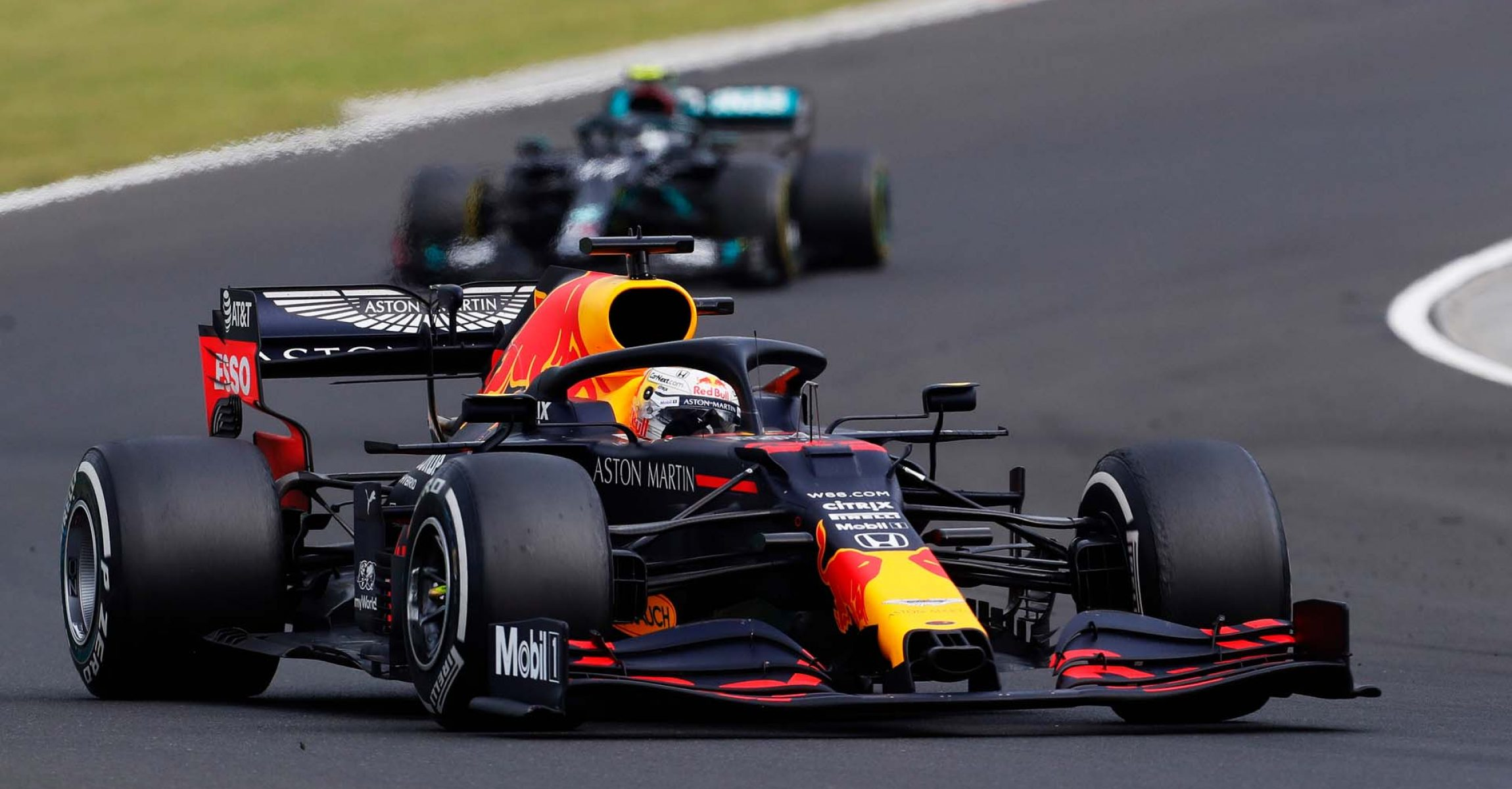 BUDAPEST, HUNGARY - JULY 19: Max Verstappen of the Netherlands driving the (33) Aston Martin Red Bull Racing RB16 leads Valtteri Bottas of Finland driving the (77) Mercedes AMG Petronas F1 Team Mercedes W11 during the Formula One Grand Prix of Hungary at Hungaroring on July 19, 2020 in Budapest, Hungary. (Photo by Darko Bandic/Pool via Getty Images) // Getty Images / Red Bull Content Pool  // AP-24P72V1212111 // Usage for editorial use only //