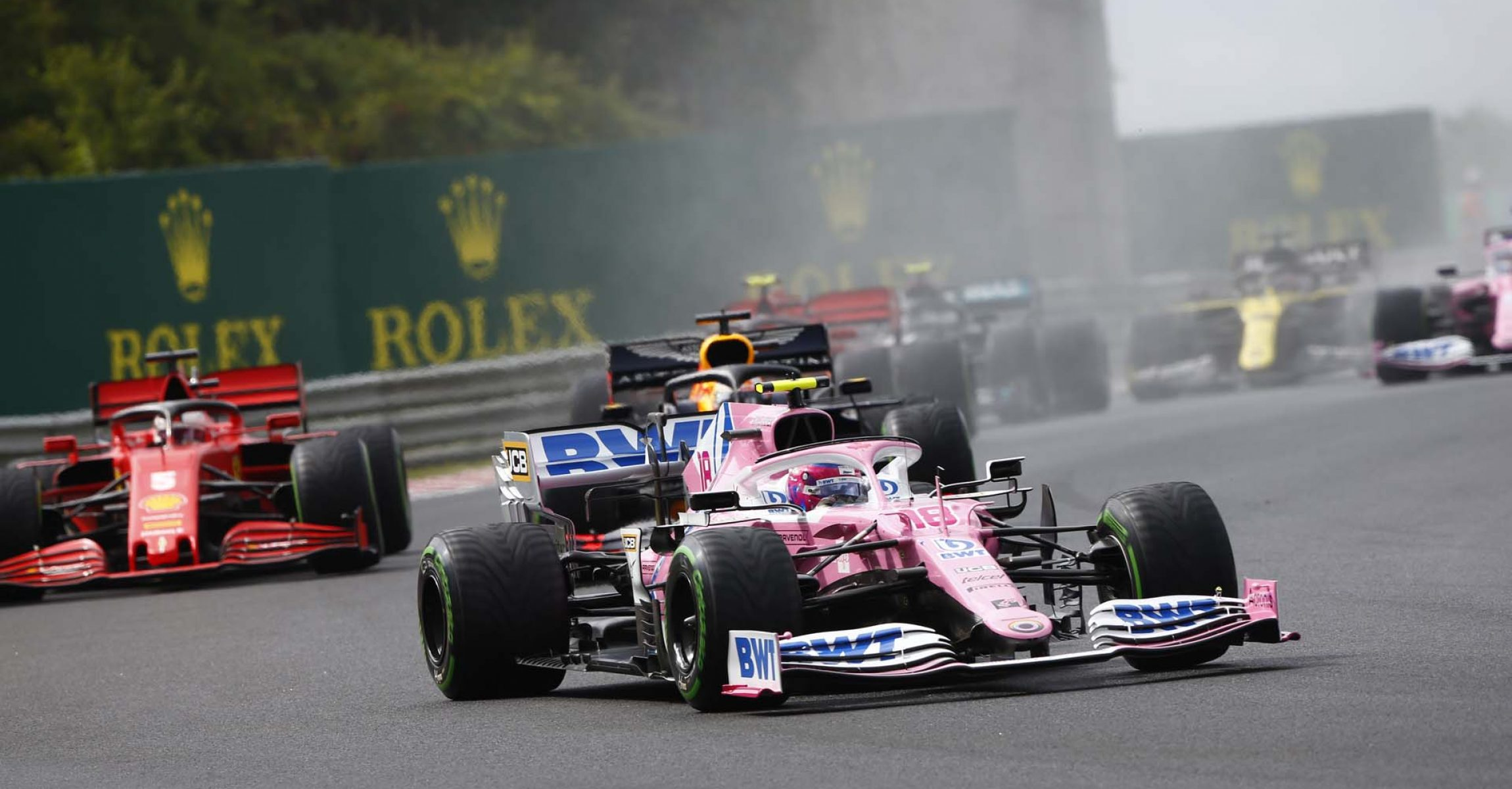 Lance Stroll, Racing Point RP20, leads Max Verstappen, Red Bull Racing RB16, and Sebastian Vettel, Ferrari SF1000