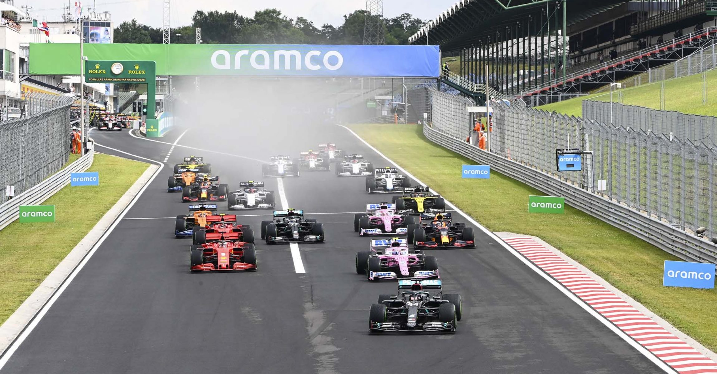 Lewis Hamilton, Mercedes F1 W11 EQ Performance leads Lance Stroll, Racing Point RP20 and Sebastian Vettel, Ferrari SF1000 at the start of the race
