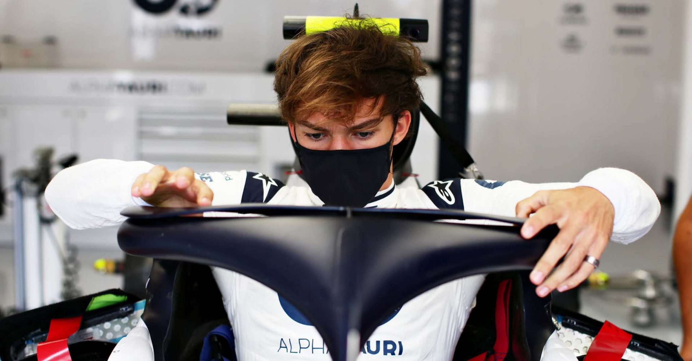 BUDAPEST, HUNGARY - JULY 16: Pierre Gasly of France and Scuderia AlphaTauri climbs into his car in the garage during previews for the F1 Grand Prix of Hungary at Hungaroring on July 16, 2020 in Budapest, Hungary. (Photo by Peter Fox/Getty Images) // Getty Images / Red Bull Content Pool  // AP-24N71FBPW1W11 // Usage for editorial use only //