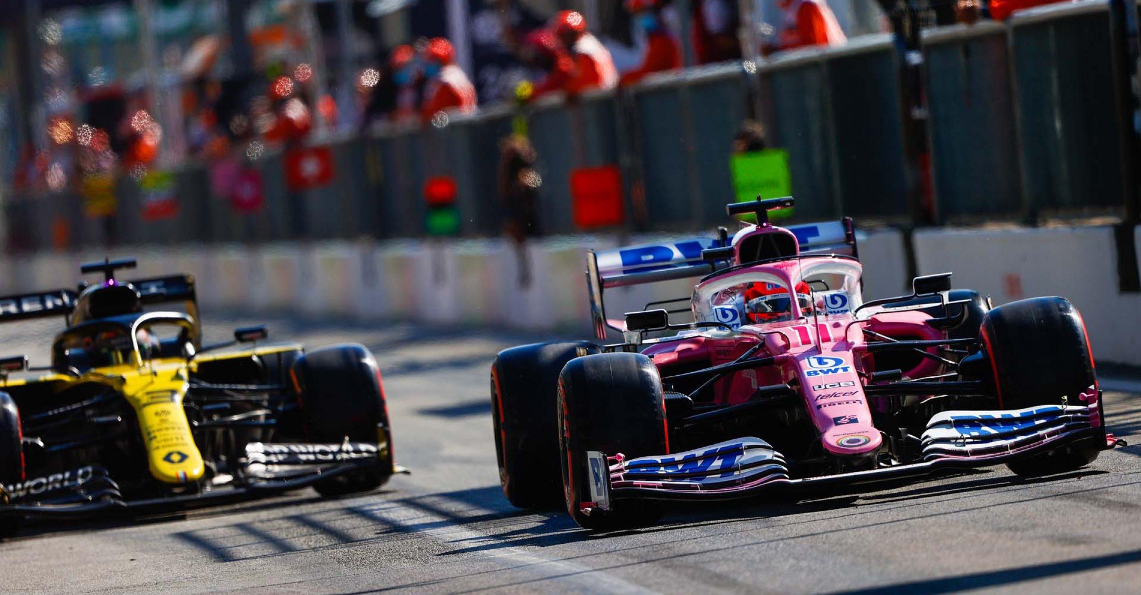 Sergio Perez, Racing Point RP20, leads Daniel Ricciardo, Renault R.S.20, in the pit lane