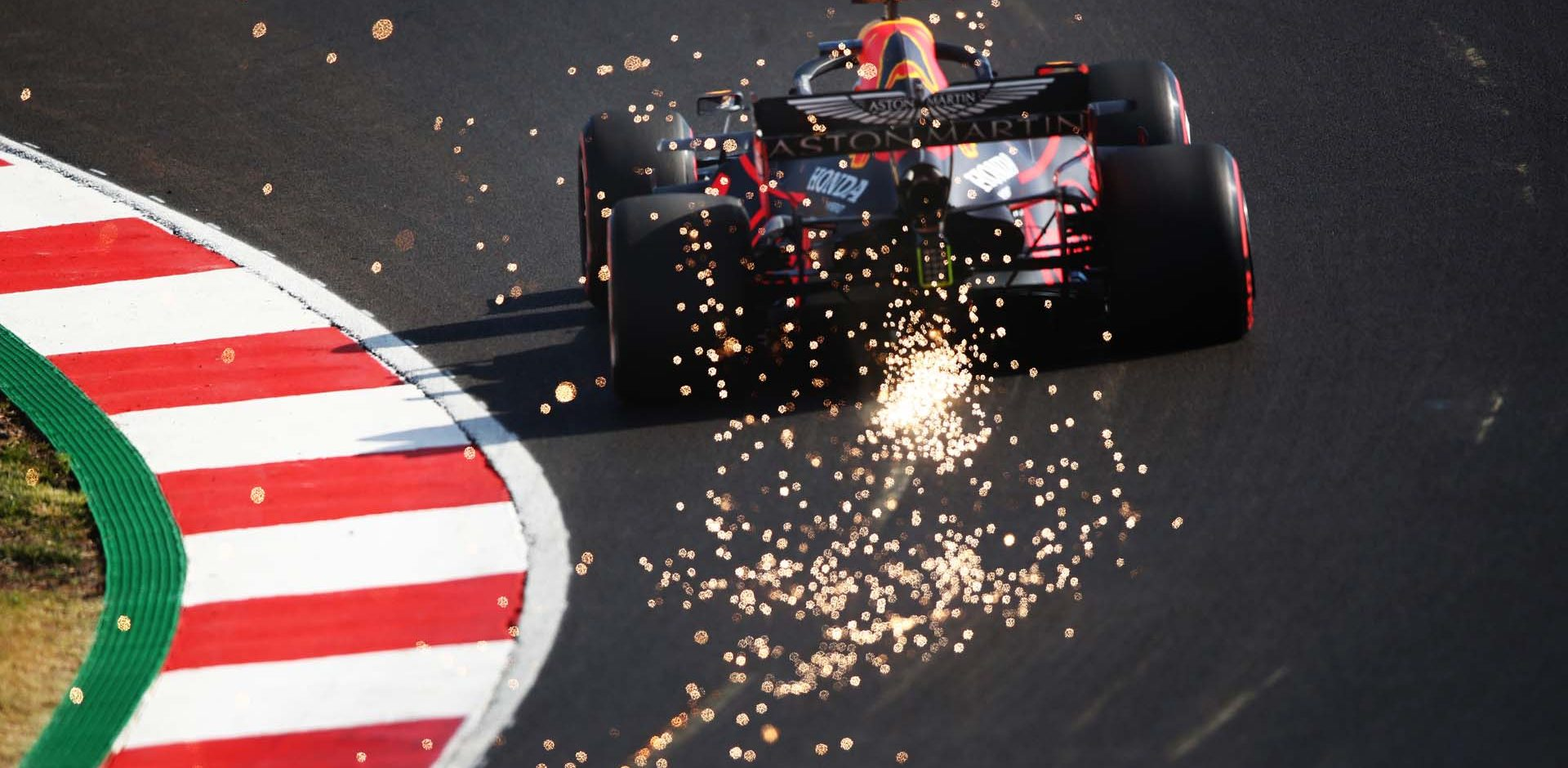PORTIMAO, PORTUGAL - OCTOBER 24: Sparks fly from the car of Max Verstappen of the Netherlands driving the (33) Aston Martin Red Bull Racing RB16 during qualifying ahead of the F1 Grand Prix of Portugal at Autodromo Internacional do Algarve on October 24, 2020 in Portimao, Portugal. (Photo by Joe Portlock/Getty Images) beatuy