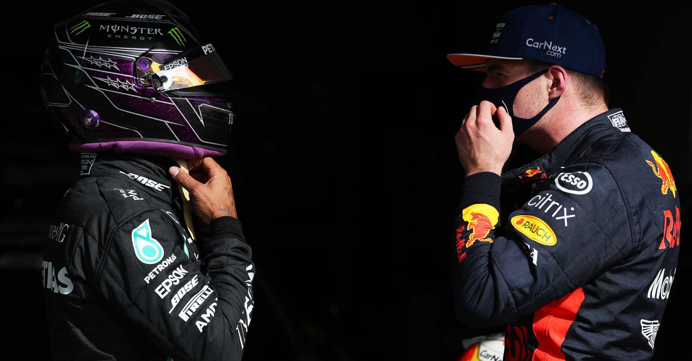 PORTIMAO, PORTUGAL - OCTOBER 24: Pole position qualifier Lewis Hamilton of Great Britain and Mercedes GP speaks with third placed Max Verstappen of Netherlands and Red Bull Racing in parc ferme during qualifying ahead of the F1 Grand Prix of Portugal at Autodromo Internacional do Algarve on October 24, 2020 in Portimao, Portugal. (Photo by Jose Sena Goulao - Pool/Getty Images)