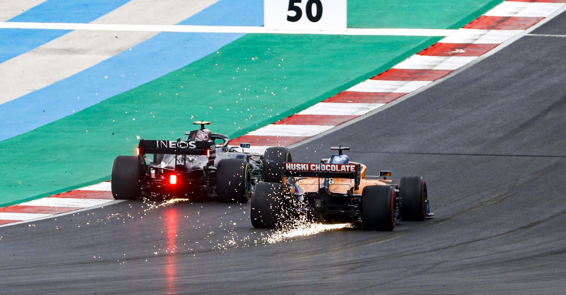 Valtteri Bottas, Mercedes F1 W11 EQ Performance, leads Carlos Sainz, McLaren MCL35