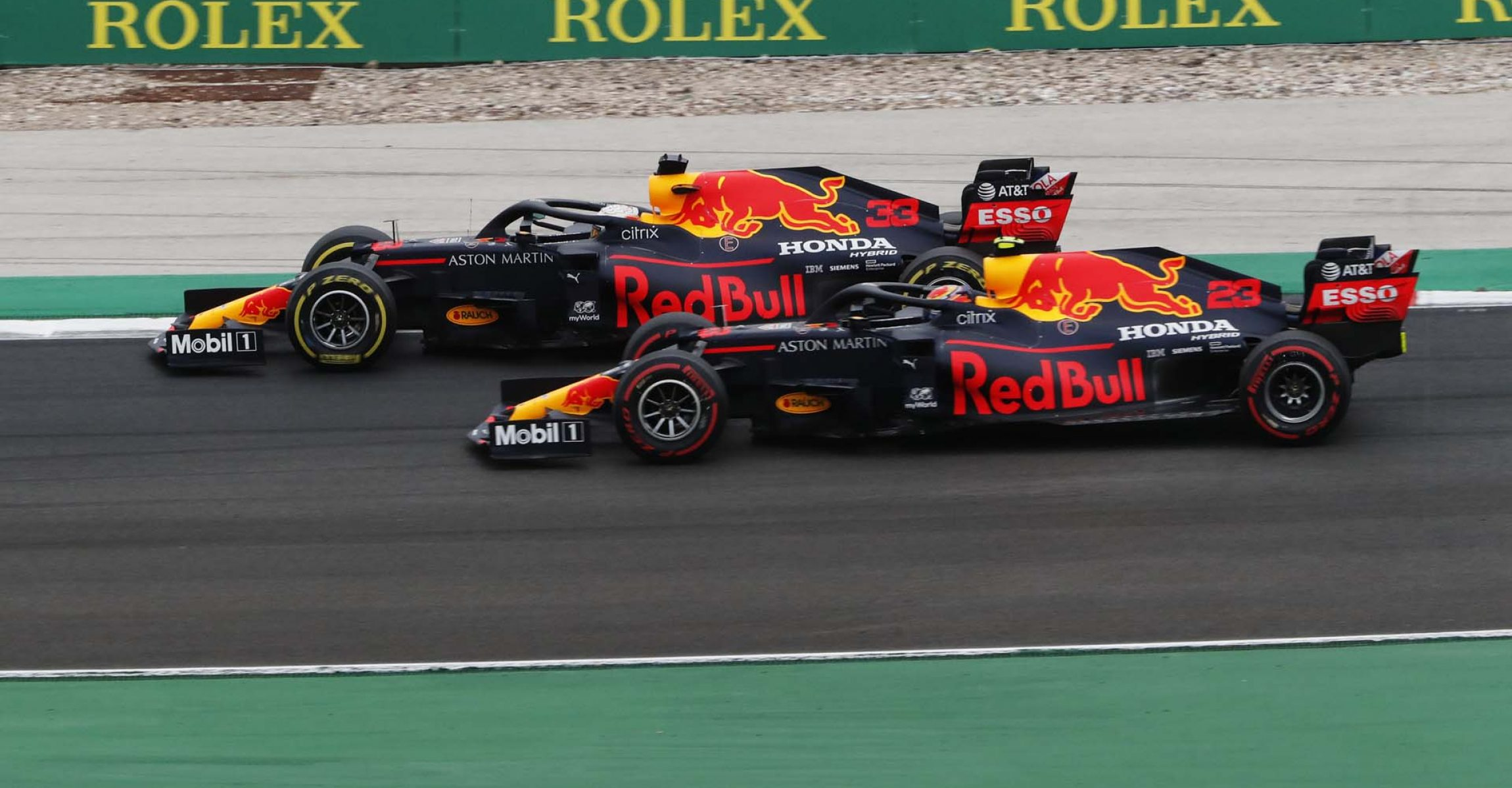PORTIMAO, PORTUGAL - OCTOBER 25: Max Verstappen of the Netherlands driving the (33) Aston Martin Red Bull Racing RB16 and Alexander Albon of Thailand driving the (23) Aston Martin Red Bull Racing RB16 battle for position on track during the F1 Grand Prix of Portugal at Autodromo Internacional do Algarve on October 25, 2020 in Portimao, Portugal. (Photo by Armando Franca - Pool/Getty Images)