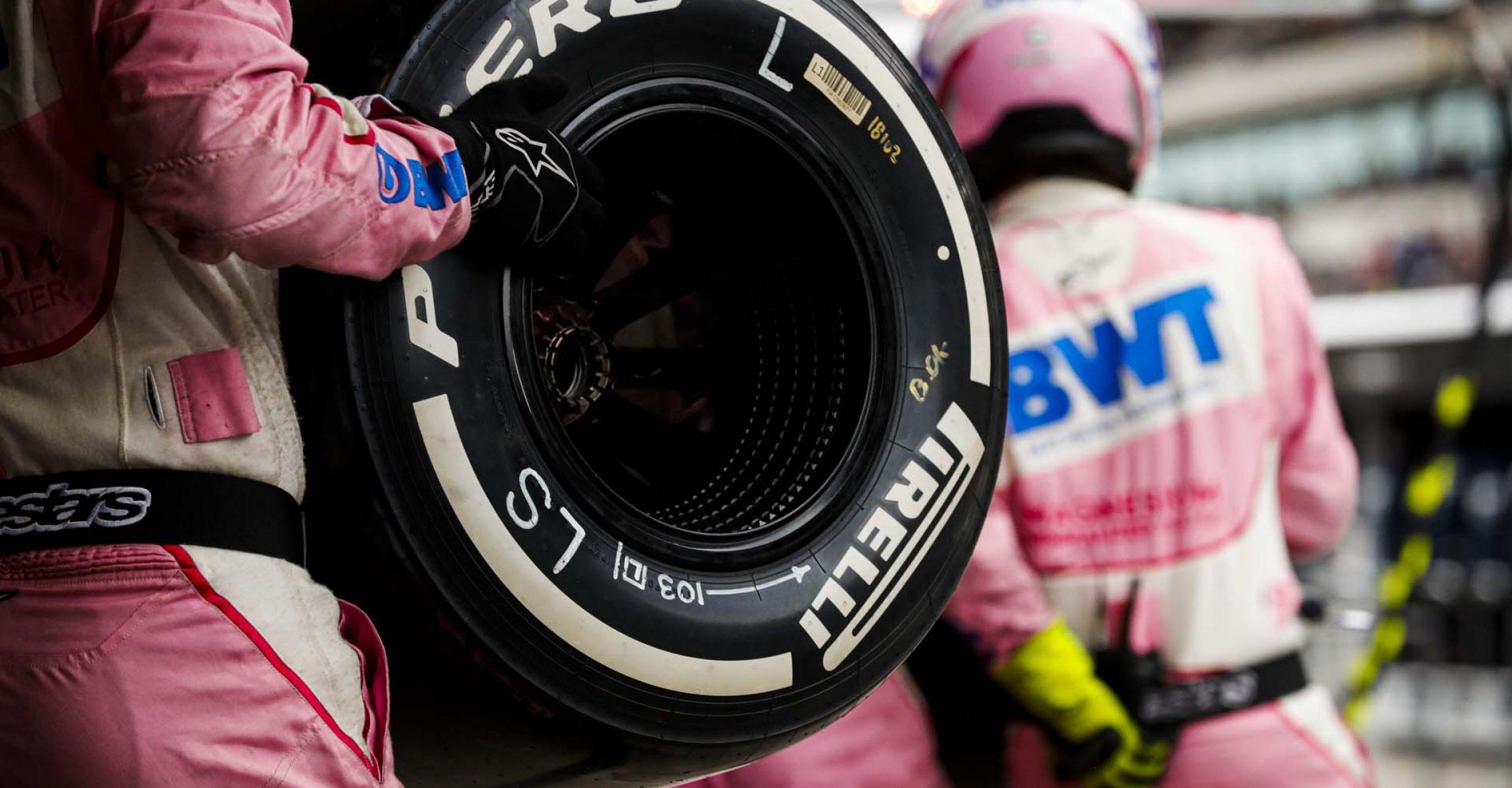 Racing Point Mechanic with Pirelli tire
