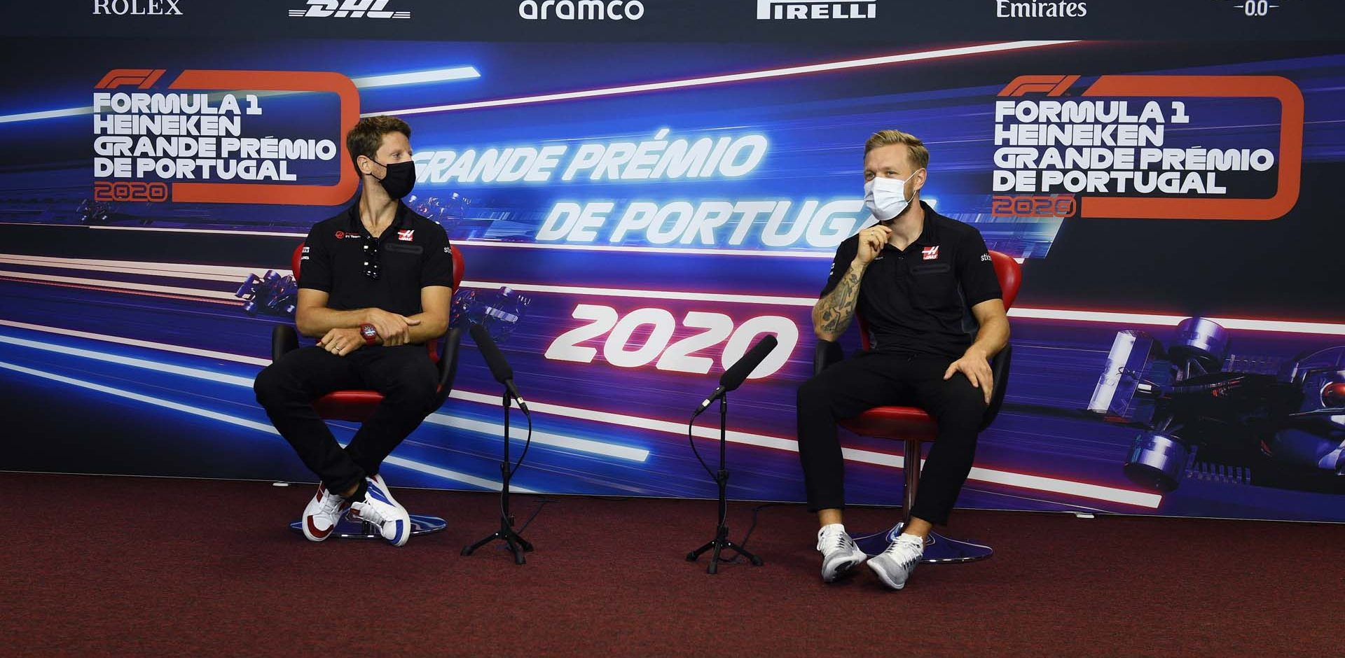ALGARVE INTERNATIONAL CIRCUIT, PORTUGAL - OCTOBER 22: Romain Grosjean, Haas F1, and Kevin Magnussen, Haas F1, in the press conference during the Portuguese GP at Algarve International Circuit on Thursday October 22, 2020, Portugal. (Copyright Free for Editorial Use Only. Credit: FIA Pool / LAT Images)