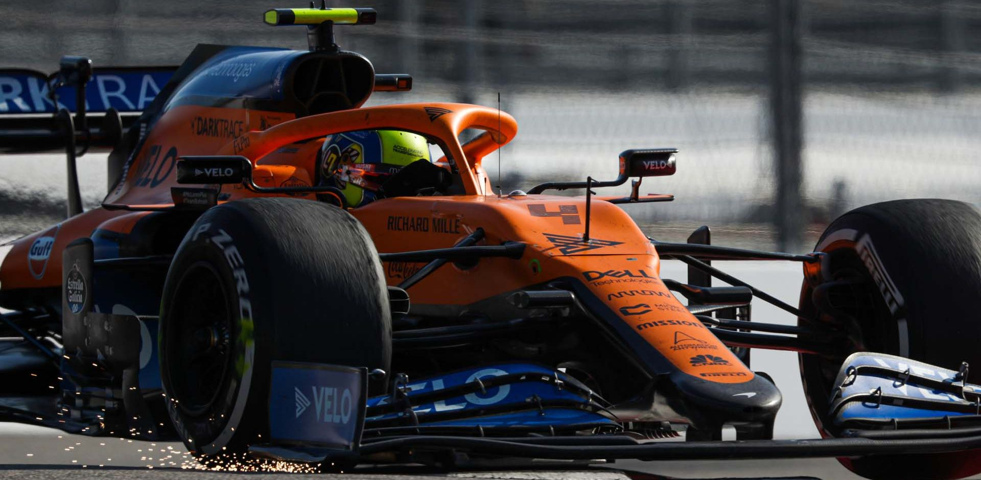 Sparks fly from the front wing of Lando Norris, McLaren MCL35
