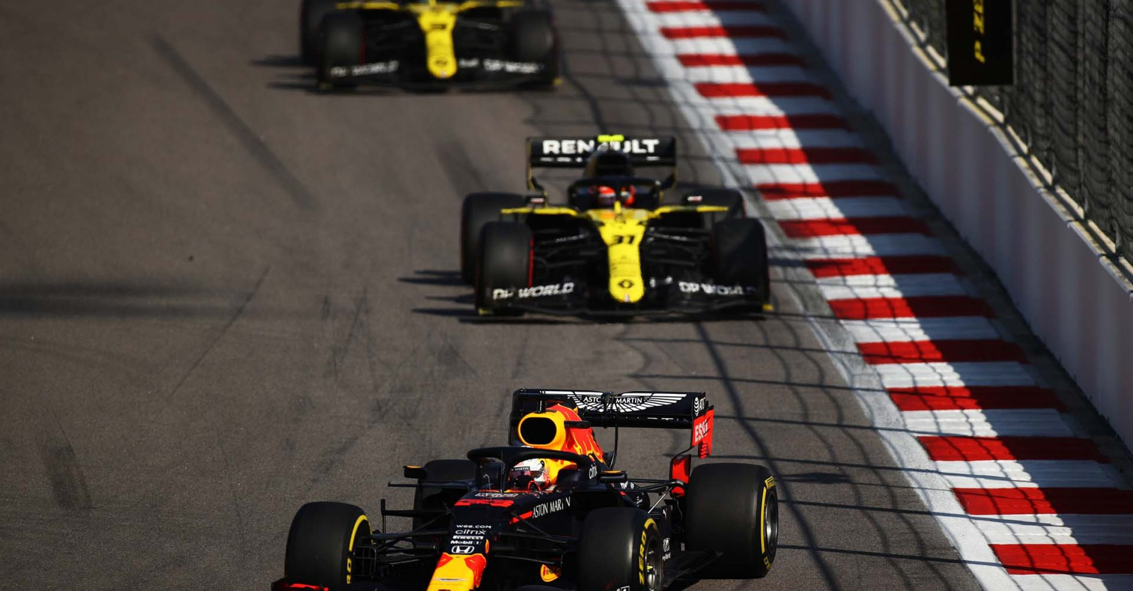 SOCHI, RUSSIA - SEPTEMBER 27: Max Verstappen of the Netherlands driving the (33) Aston Martin Red Bull Racing RB16 leads Esteban Ocon of France driving the (31) Renault Sport Formula One Team RS20 and Daniel Ricciardo of Australia driving the (3) Renault Sport Formula One Team RS20 during the F1 Grand Prix of Russia at Sochi Autodrom on September 27, 2020 in Sochi, Russia. (Photo by Bryn Lennon/Getty Images)