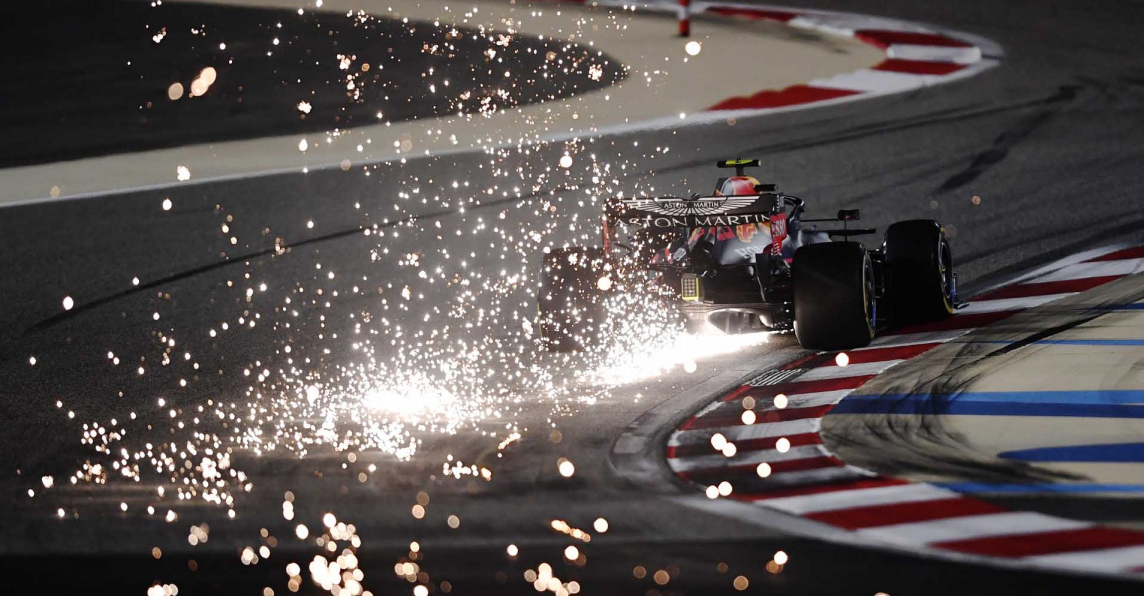 BAHRAIN, BAHRAIN - DECEMBER 04: Sparks fly behind Alexander Albon of Thailand driving the (23) Aston Martin Red Bull Racing RB16 during practice ahead of the F1 Grand Prix of Sakhir at Bahrain International Circuit on December 04, 2020 in Bahrain, Bahrain. (Photo by Rudy Carezzevoli/Getty Images) beauty