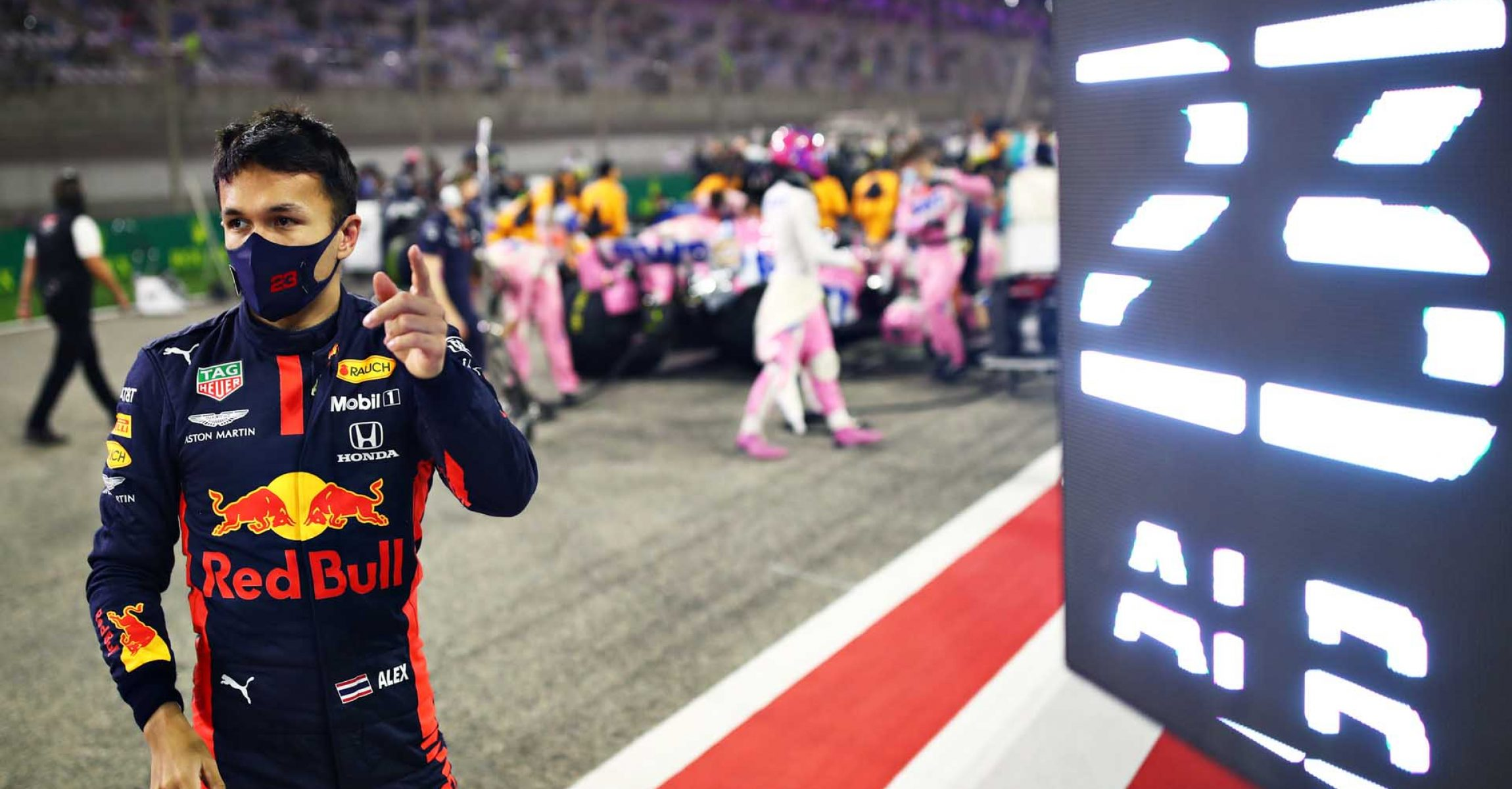 BAHRAIN, BAHRAIN - DECEMBER 06: Alexander Albon of Thailand and Red Bull Racing prepares to drive on the grid before the F1 Grand Prix of Sakhir at Bahrain International Circuit on December 06, 2020 in Bahrain, Bahrain. (Photo by Mark Thompson/Getty Images)