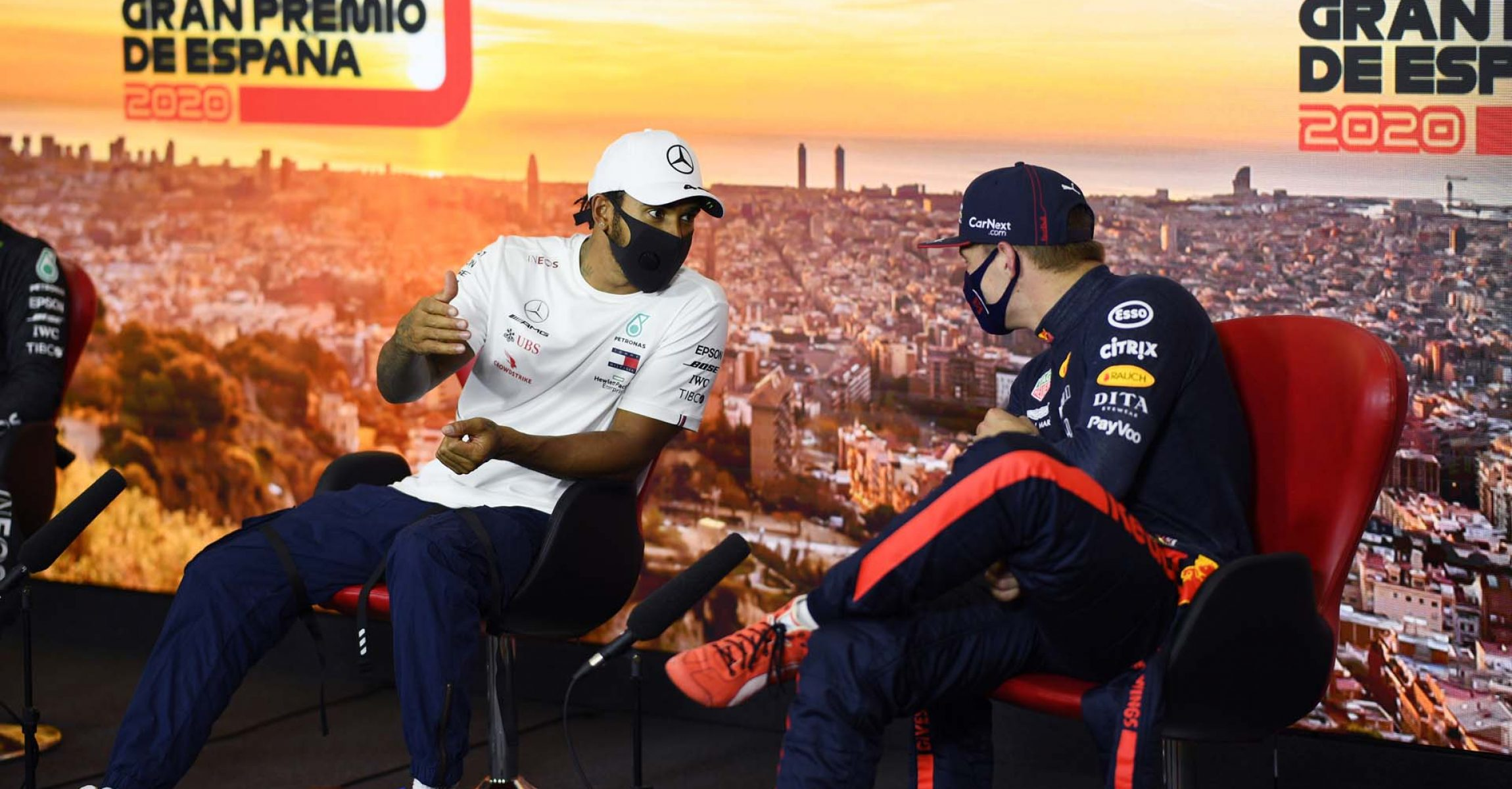BARCELONA, SPAIN - AUGUST 15: Third placed qualifier Max Verstappen of Netherlands and Red Bull Racing and pole position qualifier Lewis Hamilton of Great Britain and Mercedes GP talk in the Drivers Press Conference during qualifying for the F1 Grand Prix of Spain at Circuit de Barcelona-Catalunya on August 15, 2020 in Barcelona, Spain. (Photo by Rudy Carezzevoli/Getty Images)