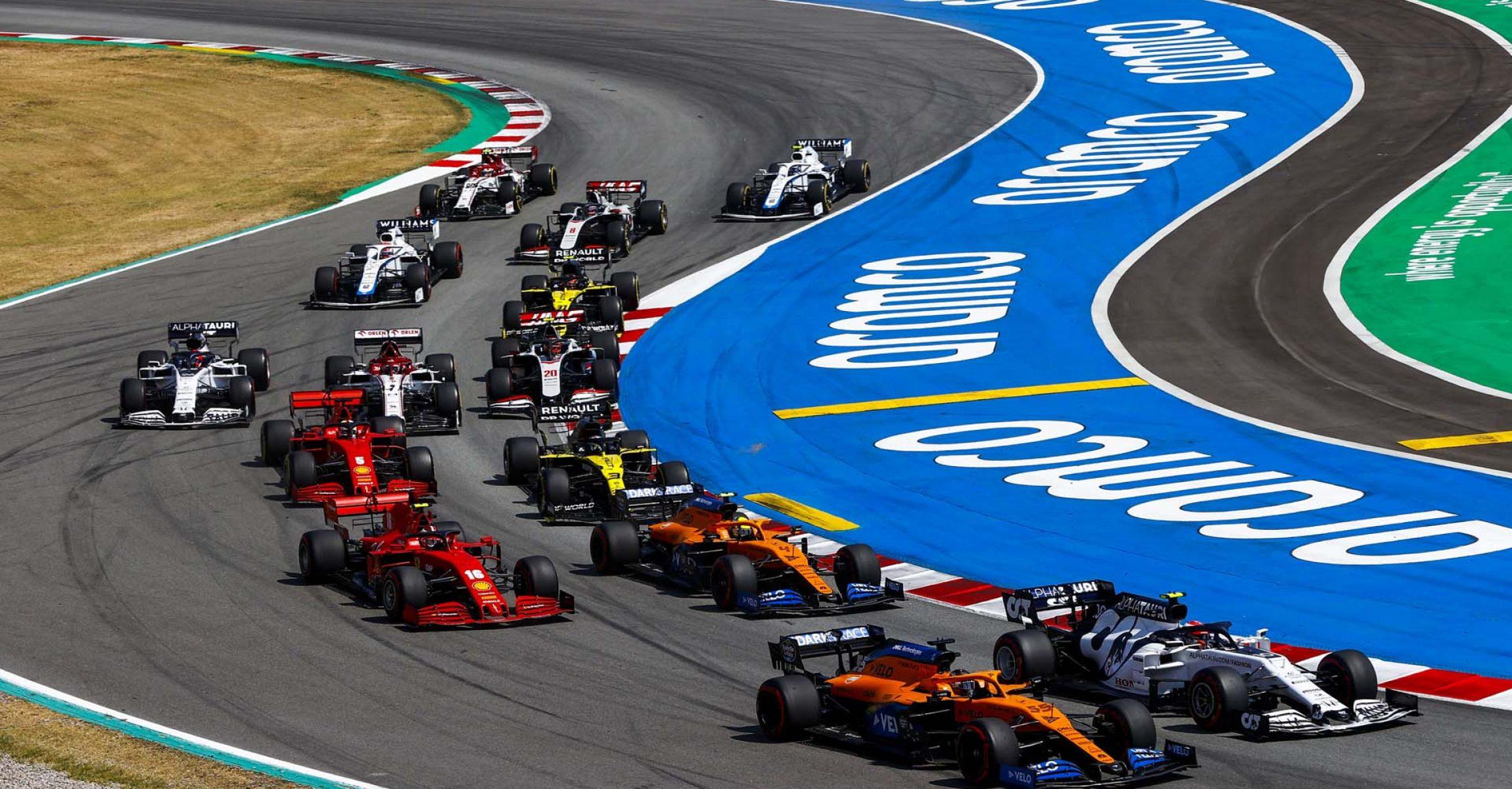 Carlos Sainz, McLaren MCL35, leads Pierre Gasly, AlphaTauri AT01, Lando Norris, McLaren MCL35, Charles Leclerc, Ferrari SF1000, Daniel Ricciardo, Renault R.S.20, Sebastian Vettel, Ferrari SF1000, and the remainder of the field at the start