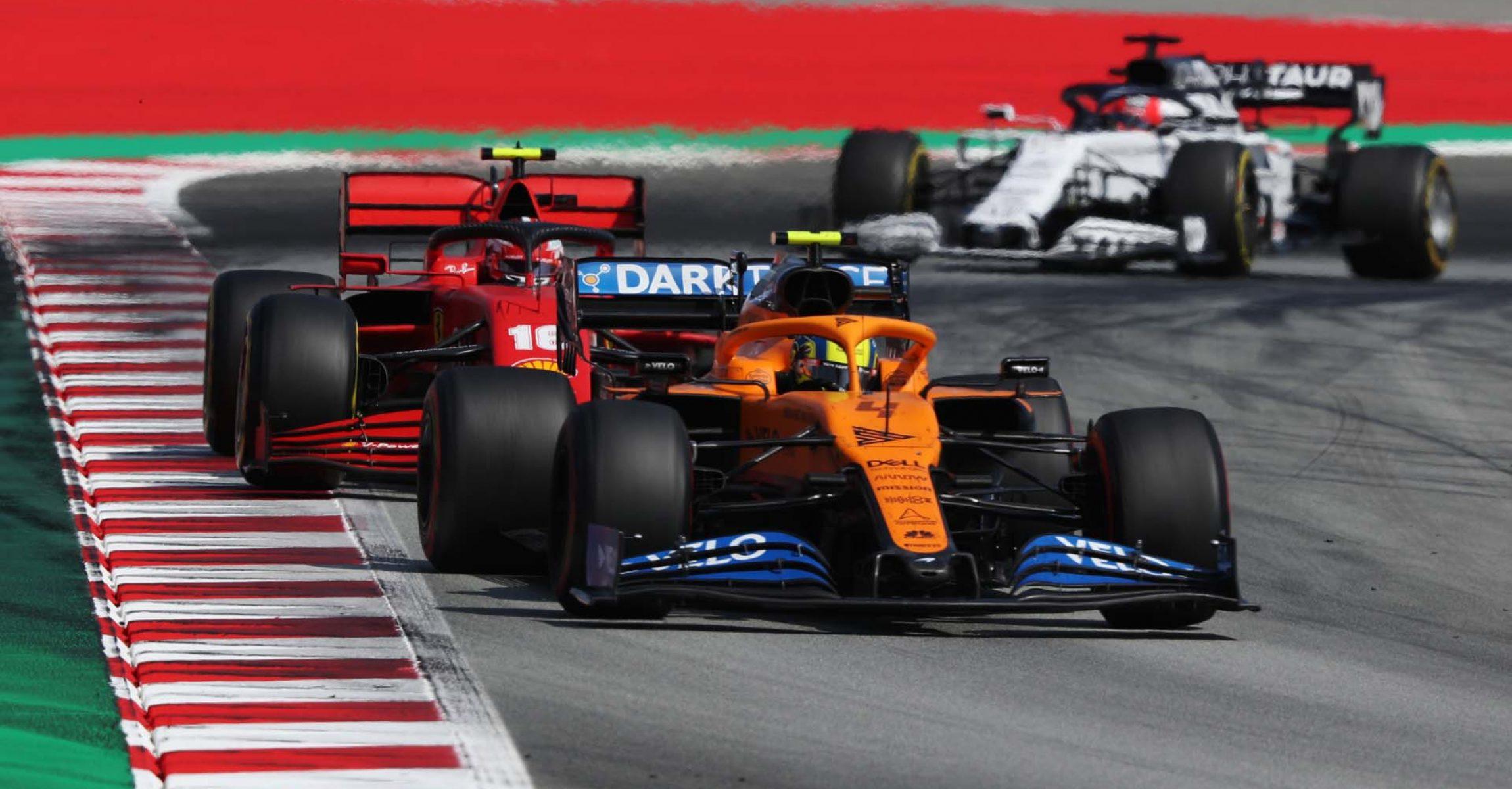 Lando Norris, McLaren MCL35, leads Charles Leclerc, Ferrari SF1000, and Daniil Kvyat, AlphaTauri AT01