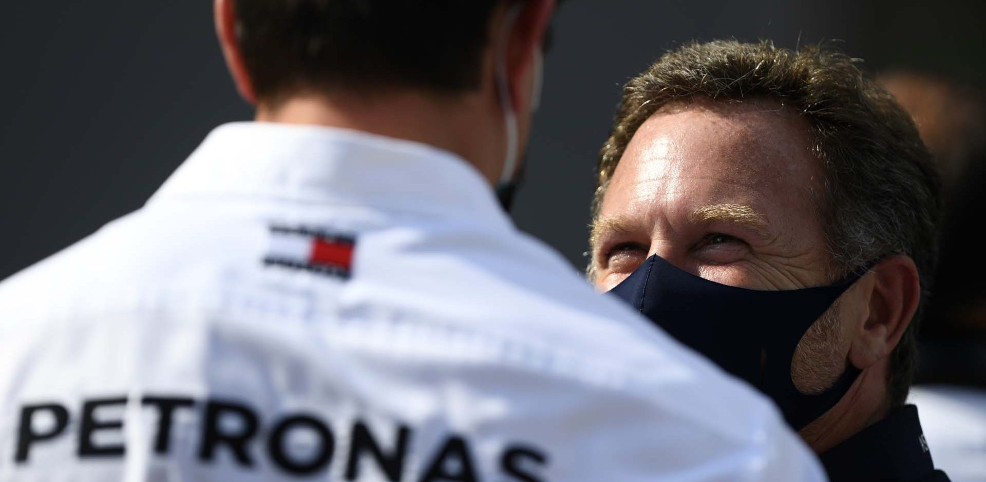 BARCELONA, SPAIN - AUGUST 16: Red Bull Racing Team Principal Christian Horner talks to Mercedes GP Executive Director Toto Wolff during the F1 Grand Prix of Spain at Circuit de Barcelona-Catalunya on August 16, 2020 in Barcelona, Spain. (Photo by Rudy Carezzevoli/Getty Images)