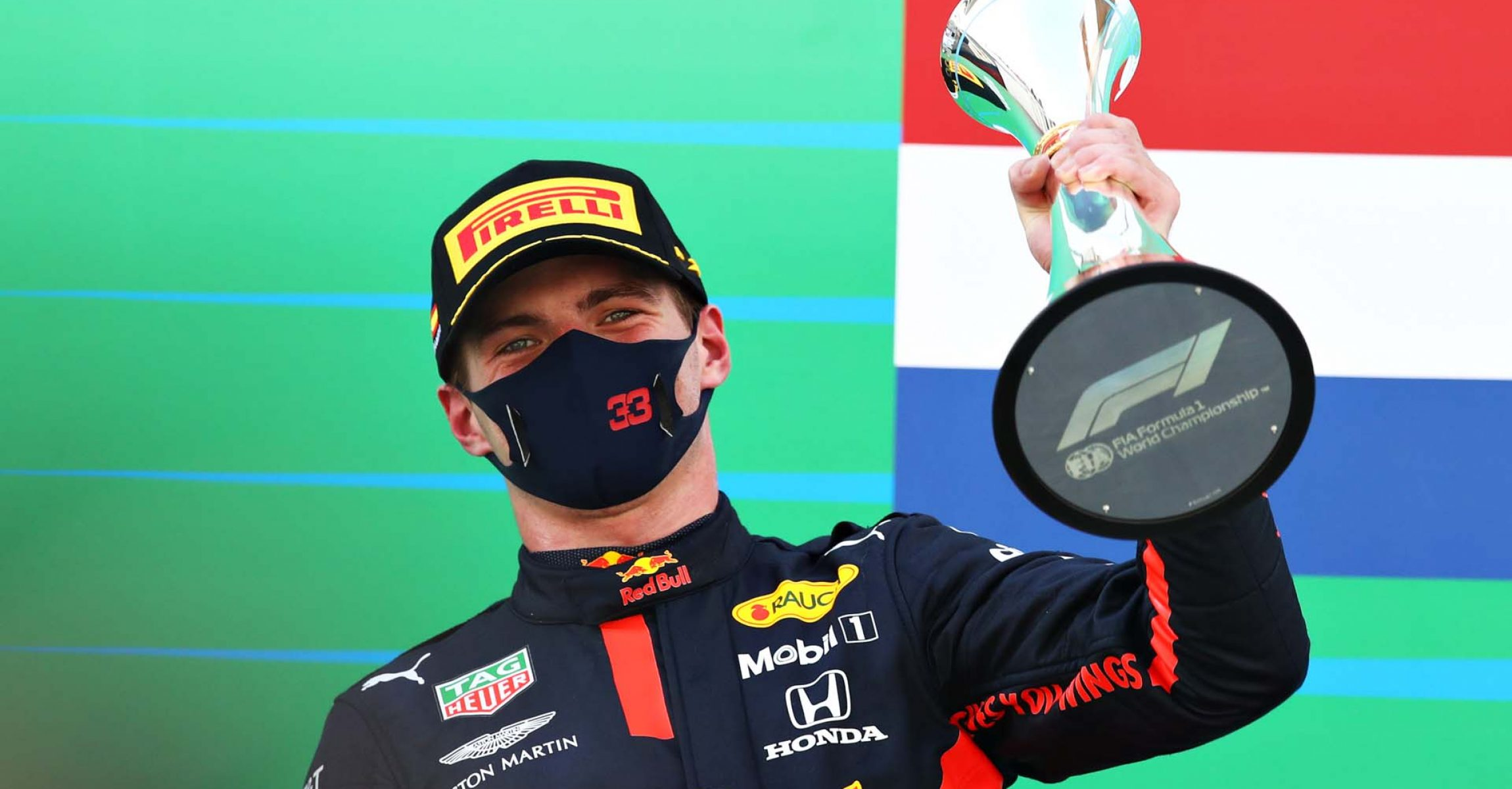 BARCELONA, SPAIN - AUGUST 16: Second placed Max Verstappen of Netherlands and Red Bull Racing celebrates on the podium during the F1 Grand Prix of Spain at Circuit de Barcelona-Catalunya on August 16, 2020 in Barcelona, Spain. (Photo by Mark Thompson/Getty Images)