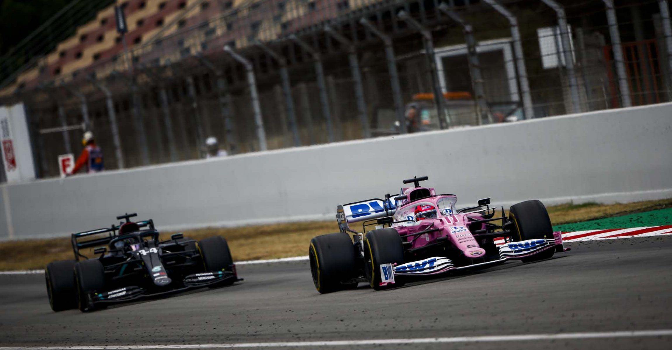 Sergio Perez, Racing Point RP20, leads Lewis Hamilton, Mercedes F1 W11 EQ Performance