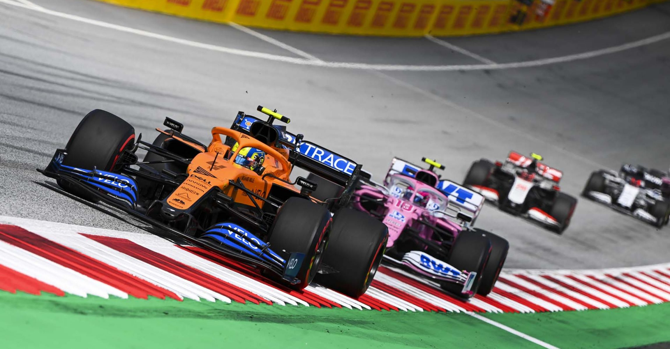 RED BULL RING, AUSTRIA - JULY 12: Lando Norris, McLaren MCL35, Lance Stroll, Racing Point RP20 during the Styrian GP at Red Bull Ring on Sunday July 12, 2020 in Spielberg, Austria. (Photo by Mark Sutton / LAT Images)