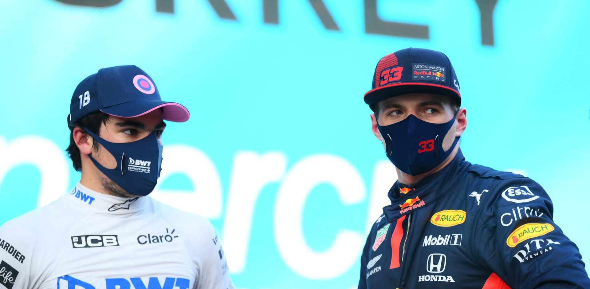 ISTANBUL, TURKEY - NOVEMBER 14: Pole position qualifier Lance Stroll of Canada and Racing Point speaks with second placed qualifier Max Verstappen of Netherlands and Red Bull Racing in parc ferme during qualifying ahead of the F1 Grand Prix of Turkey at Intercity Istanbul Park on November 14, 2020 in Istanbul, Turkey. (Photo by Clive Mason/Getty Images)
