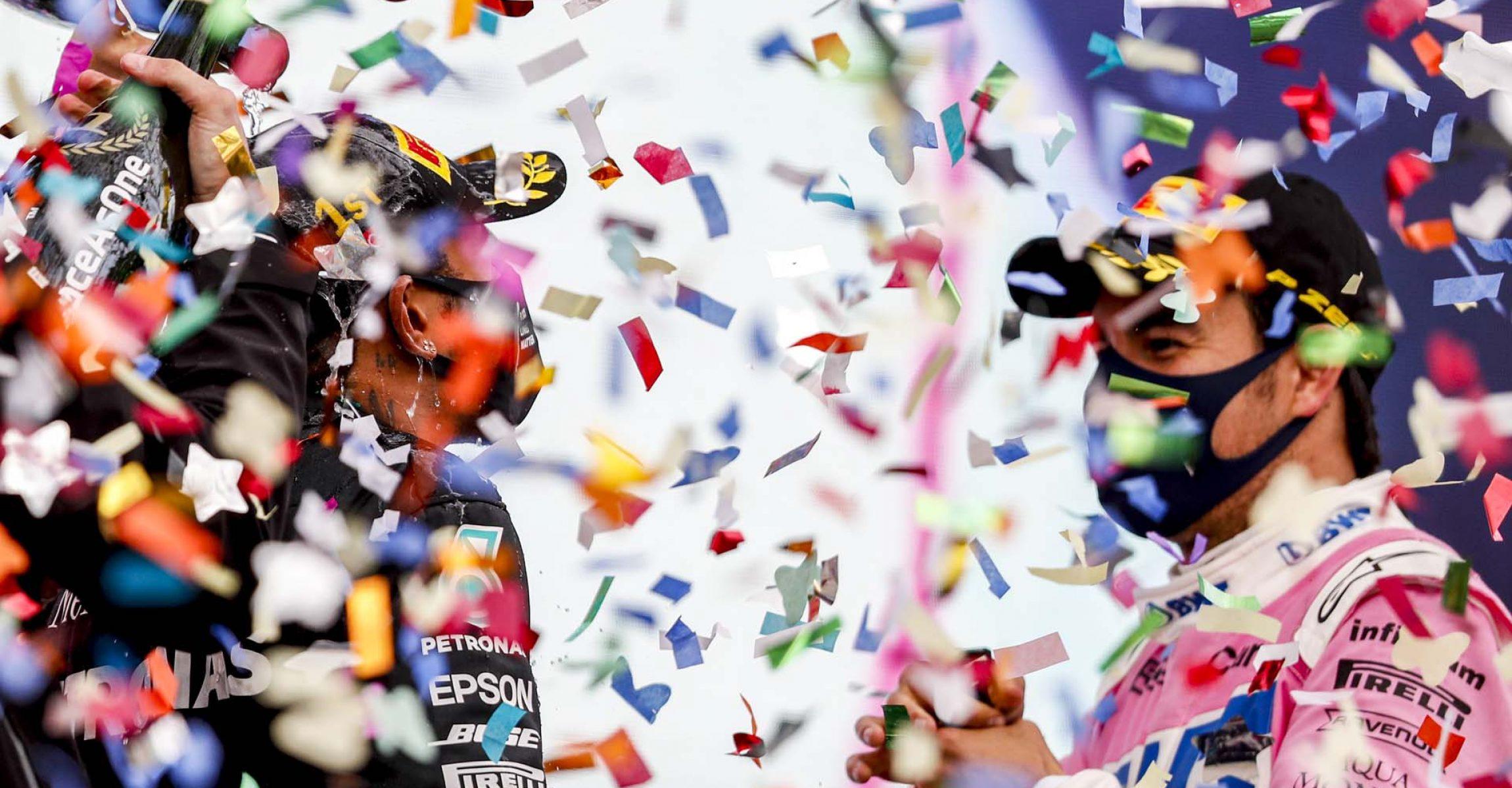 Lewis Hamilton, Mercedes-AMG Petronas F1, 1st position, and Sergio Perez, Racing Point, 2nd position, celebrates on the podium