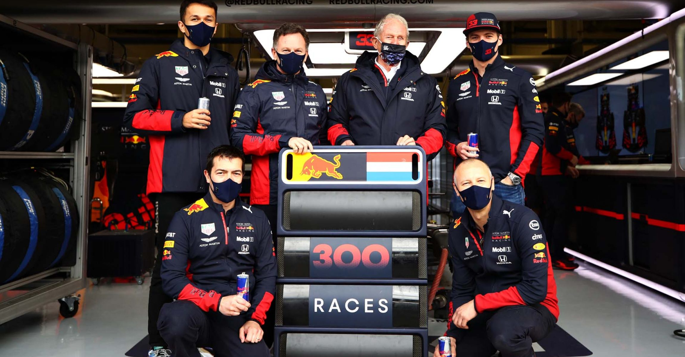 ISTANBUL, TURKEY - NOVEMBER 15: Alexander Albon of Thailand and Red Bull Racing, Red Bull Racing Team Principal Christian Horner, Red Bull Racing Team Consultant Dr Helmut Marko, Max Verstappen of Netherlands and Red Bull Racing, Ole Schack and Phil Turner of Red Bull Racing pose for a photo with a pitboard celebrating the teams 300th race before the F1 Grand Prix of Turkey at Intercity Istanbul Park on November 15, 2020 in Istanbul, Turkey. (Photo by Bryn Lennon/Getty Images)