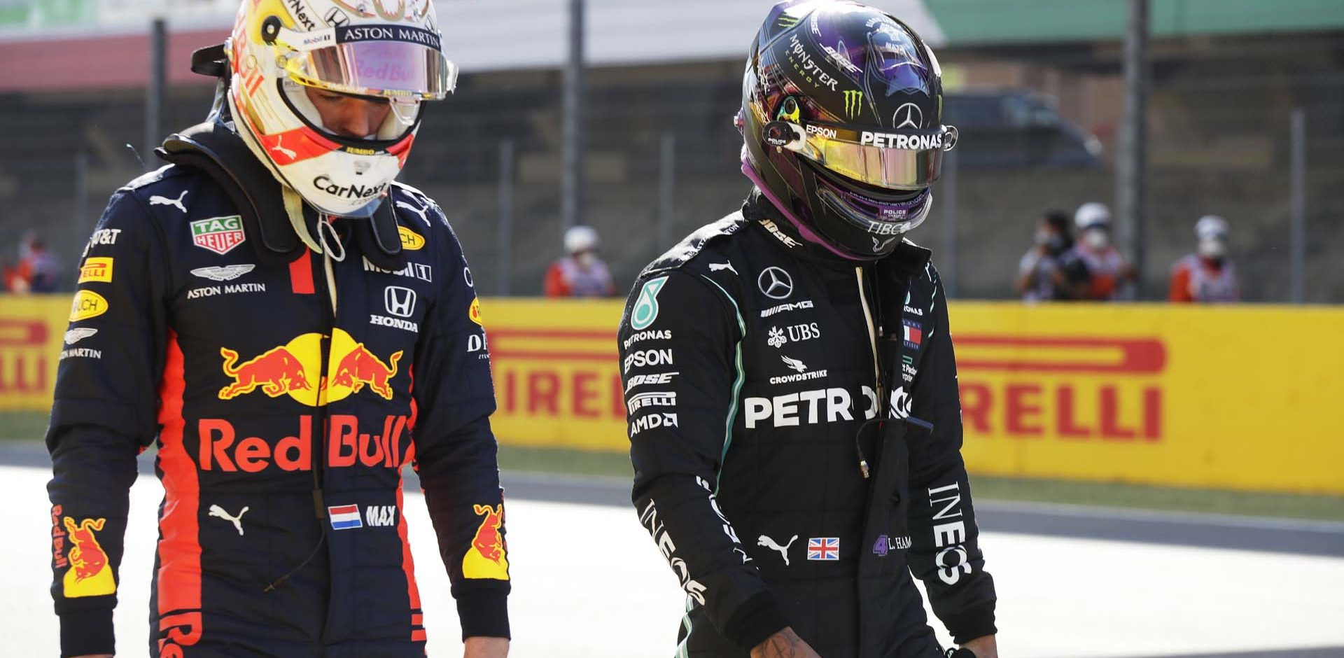 SCARPERIA, ITALY - SEPTEMBER 12: Pole position qualifier Lewis Hamilton of Great Britain and Mercedes GP and third placed qualifier Max Verstappen of Netherlands and Red Bull Racing in parc ferme during qualifying for the F1 Grand Prix of Tuscany at Mugello Circuit on September 12, 2020 in Scarperia, Italy. (Photo by Luca Bruno - Pool/Getty Images)