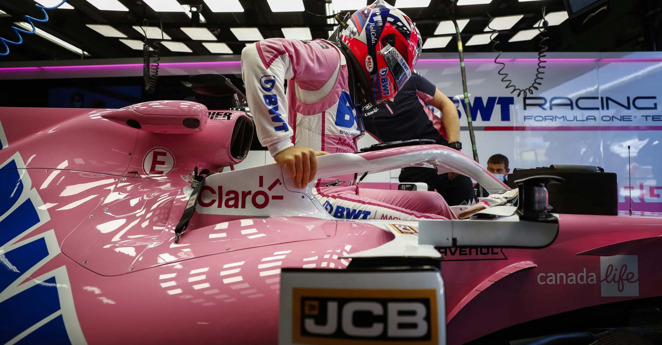 Sergio Perez, Racing Point, climbs into his cockpit