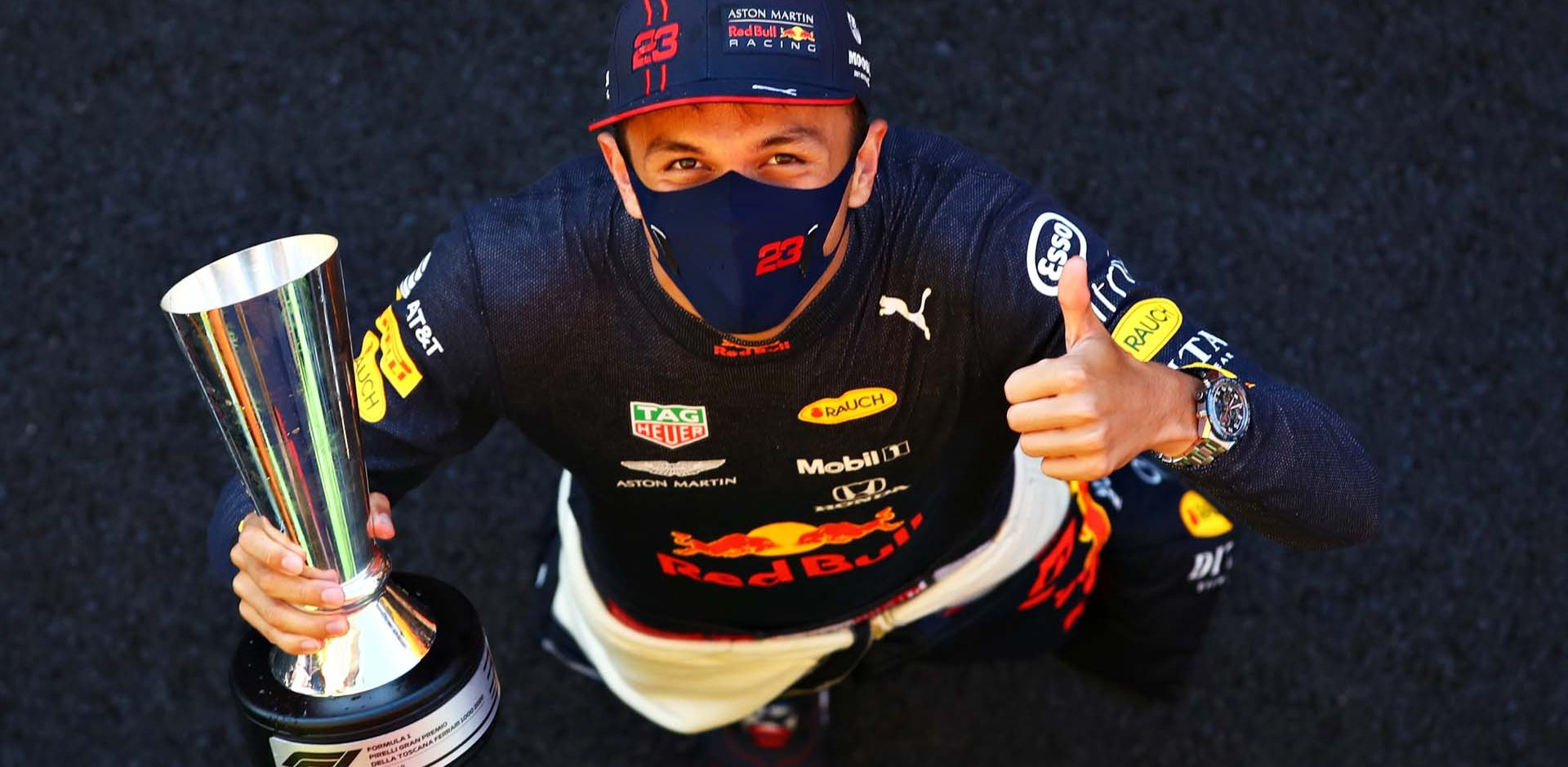 SCARPERIA, ITALY - SEPTEMBER 13: Third placed Alexander Albon of Thailand and Red Bull Racing celebrates after the F1 Grand Prix of Tuscany at Mugello Circuit on September 13, 2020 in Scarperia, Italy. (Photo by Mark Thompson/Getty Images)