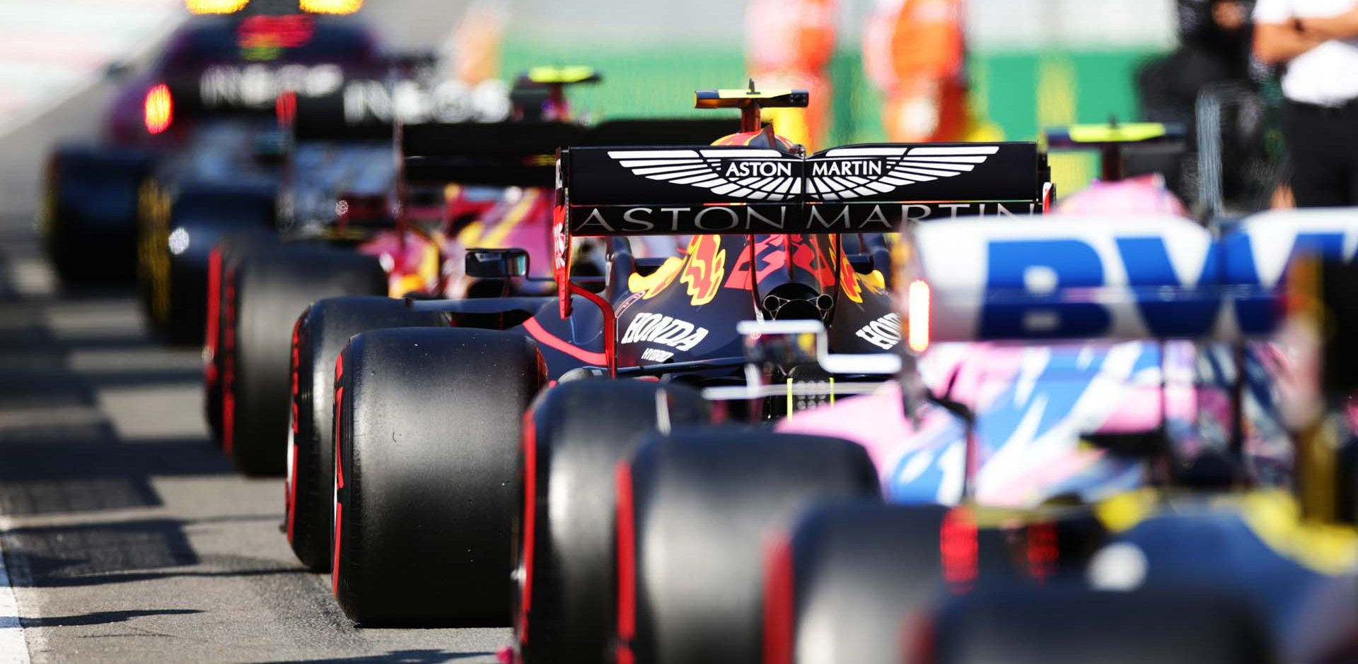 SCARPERIA, ITALY - SEPTEMBER 13: Alexander Albon of Thailand driving the (23) Aston Martin Red Bull Racing RB16 lines up in the pitlane during a red flag period during the F1 Grand Prix of Tuscany at Mugello Circuit on September 13, 2020 in Scarperia, Italy. (Photo by Peter Fox/Getty Images)