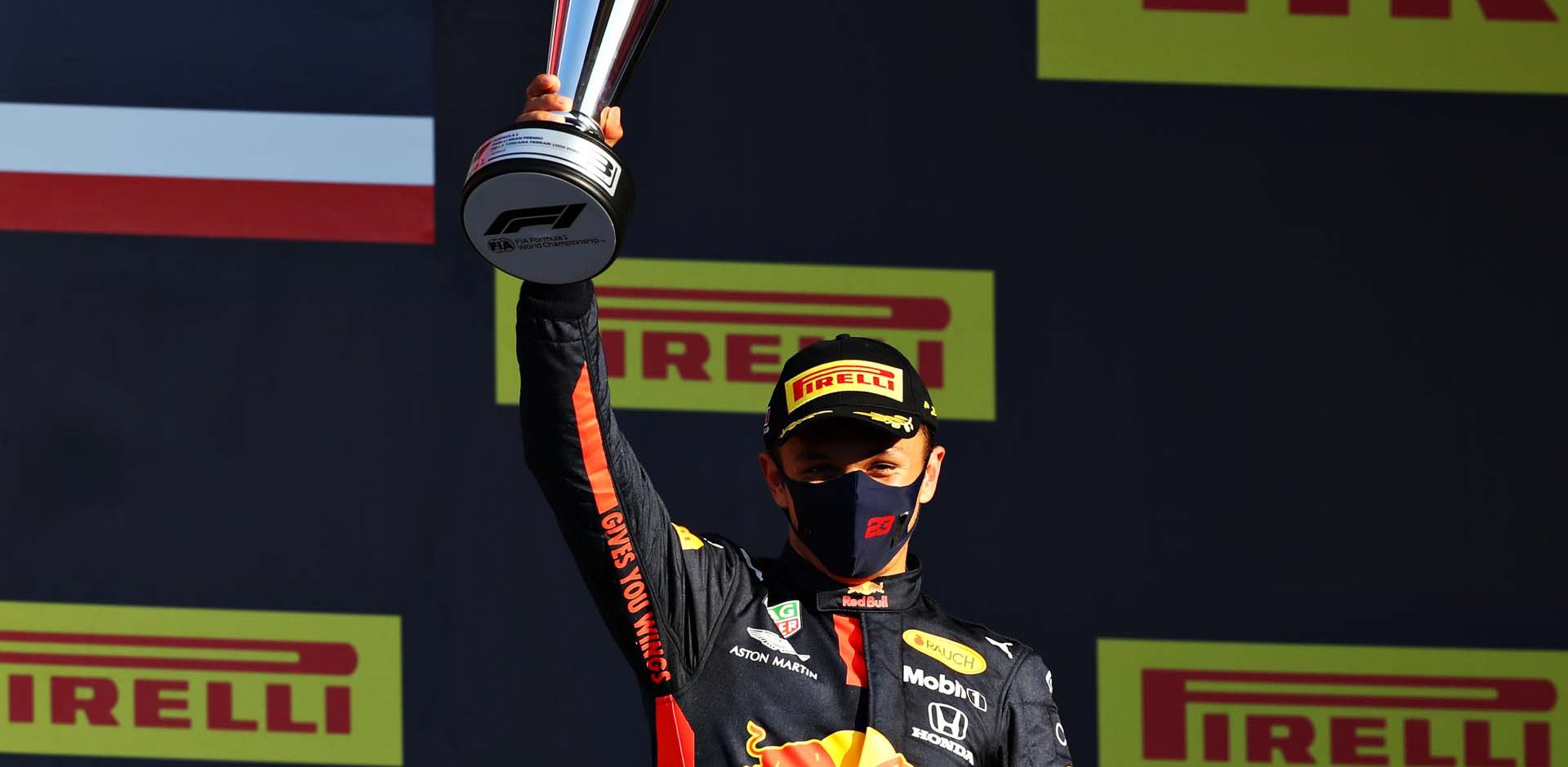 SCARPERIA, ITALY - SEPTEMBER 13: Third placed Alexander Albon of Thailand and Red Bull Racing celebrates on the podium during the F1 Grand Prix of Tuscany at Mugello Circuit on September 13, 2020 in Scarperia, Italy. (Photo by Mark Thompson/Getty Images)