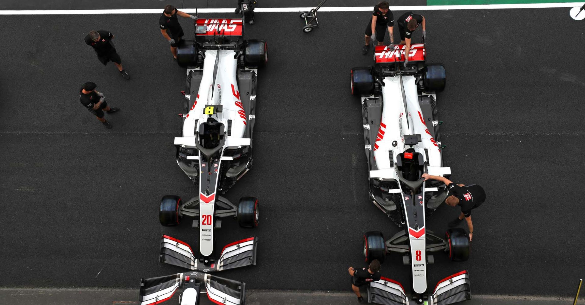MUGELLO CIRCUIT, ITALY - SEPTEMBER 10: The Kevin Magnussen Haas VF-20 and Romain Grosjean Haas VF-20 in the pit lane during the Tuscany GP at Mugello Circuit on Thursday September 10, 2020, Italy. (Photo by Charles Coates / LAT Images)