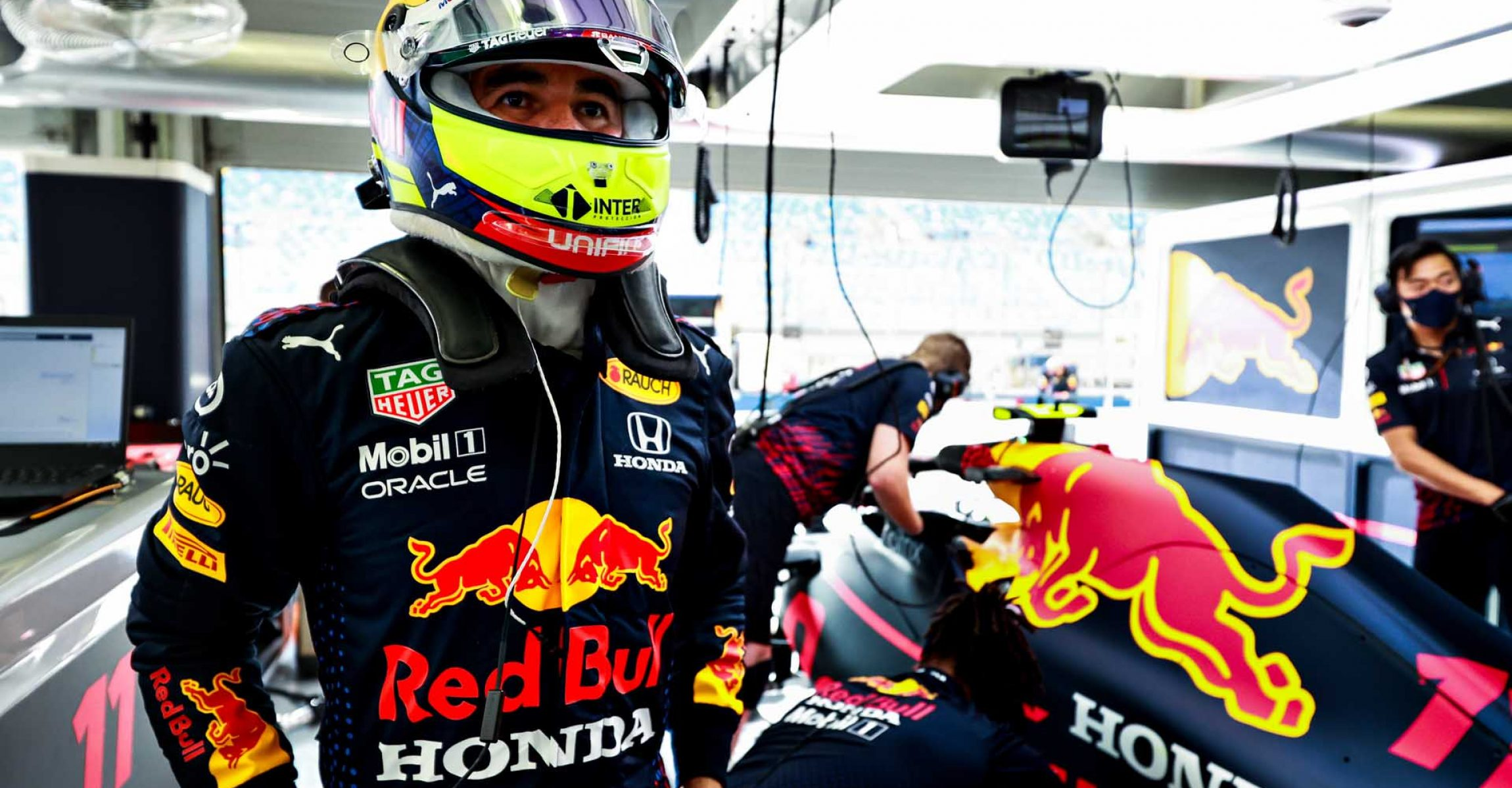 BAHRAIN, BAHRAIN - MARCH 26: Sergio Perez of Mexico and Red Bull Racing prepares to drive in the garage during practice ahead of the F1 Grand Prix of Bahrain at Bahrain International Circuit on March 26, 2021 in Bahrain, Bahrain. (Photo by Mark Thompson/Getty Images)