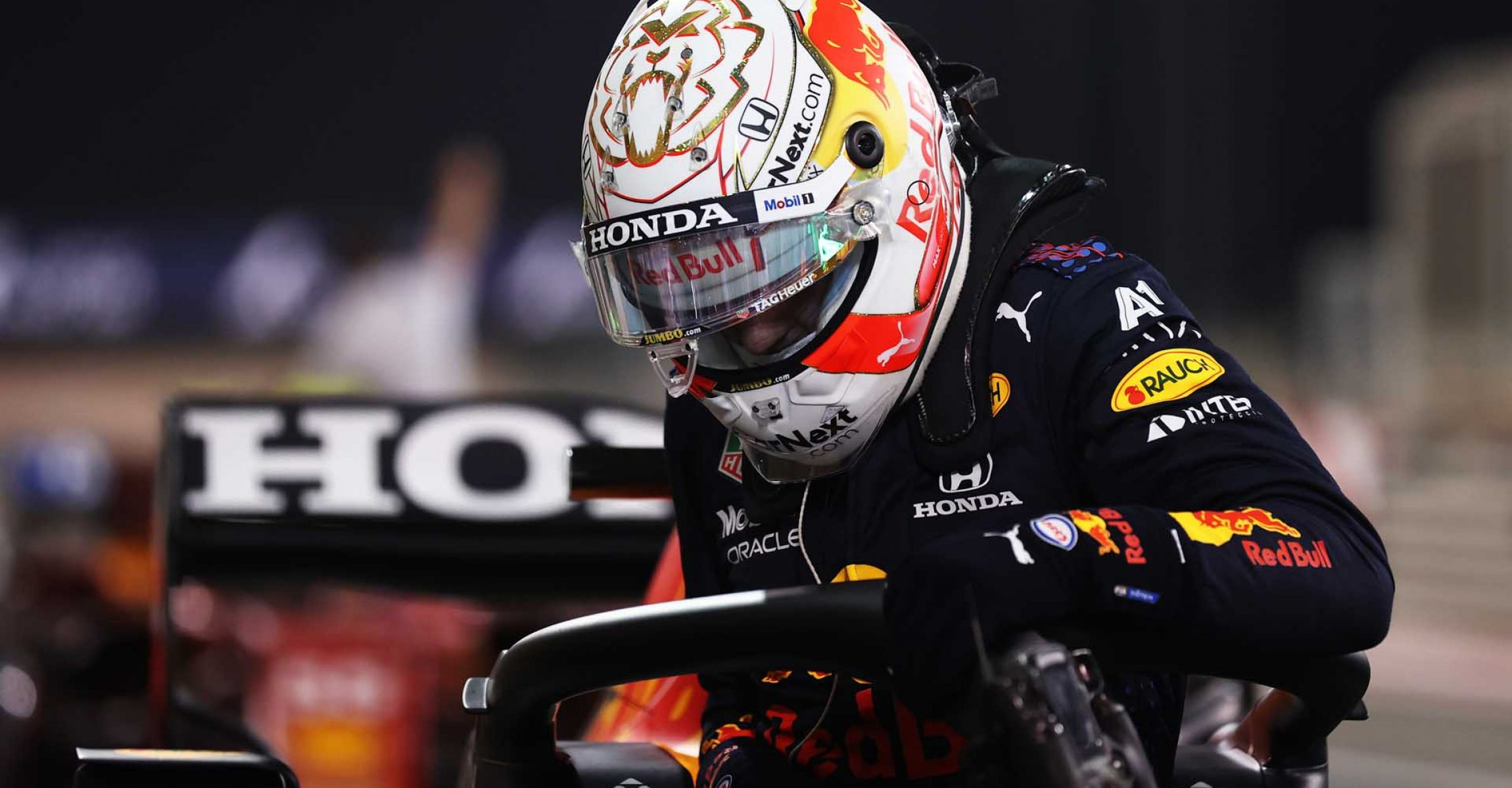 BAHRAIN, BAHRAIN - MARCH 27: Pole position qualifier Max Verstappen of Netherlands and Red Bull Racing climbs out of his car in parc ferme during qualifying ahead of the F1 Grand Prix of Bahrain at Bahrain International Circuit on March 27, 2021 in Bahrain, Bahrain. (Photo by Lars Baron/Getty Images)