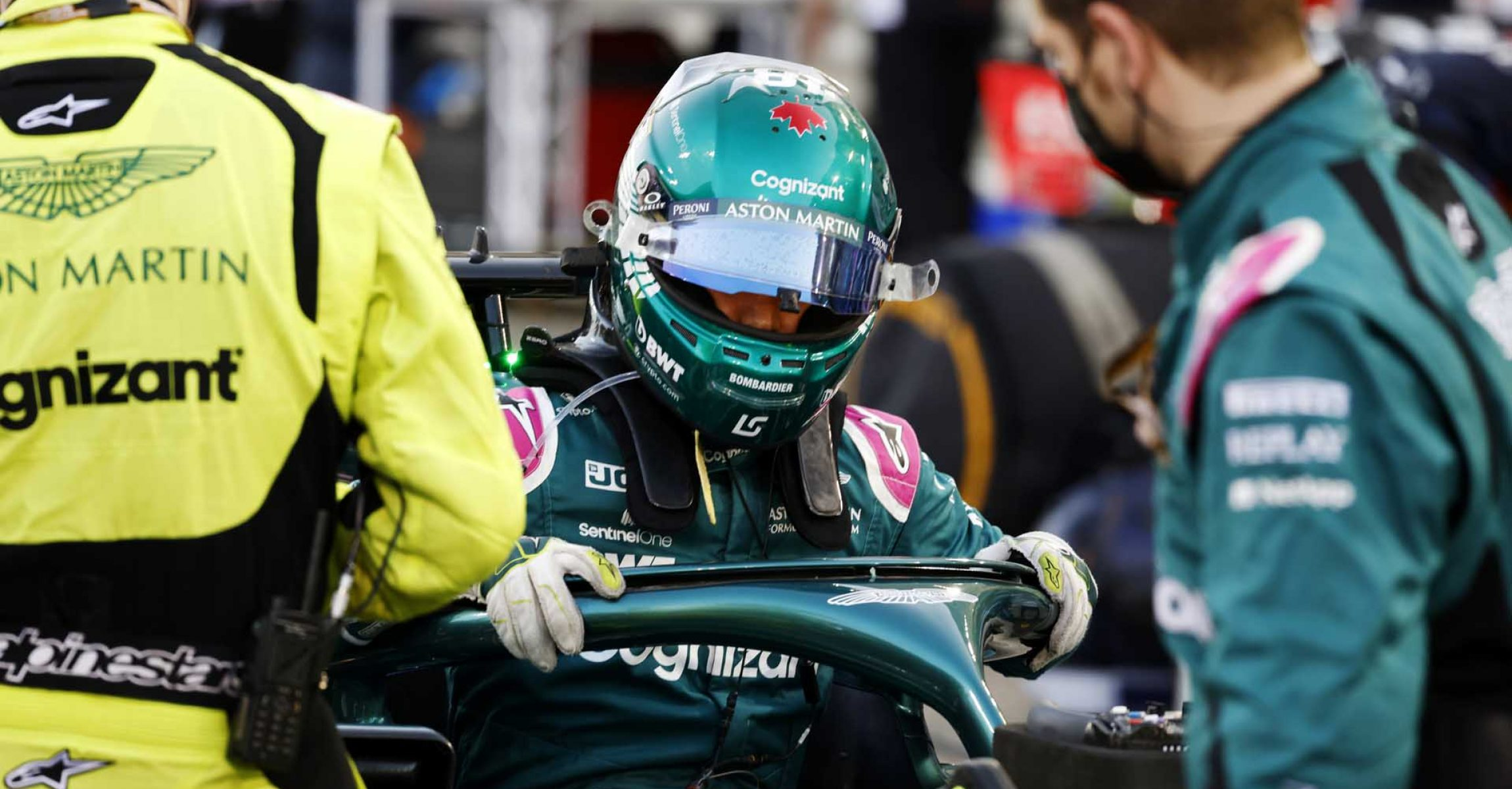 Lance Stroll, Aston Martin, climbs out of his car on the grid