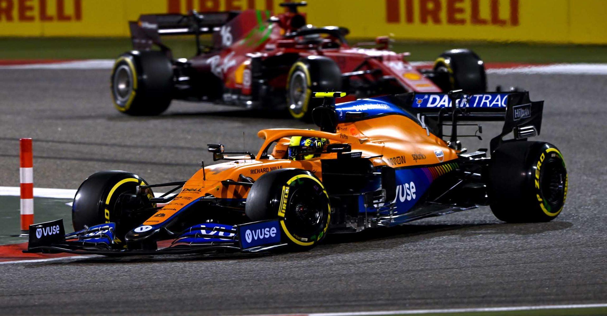 Lando Norris, McLaren MCL35M, leads Charles Leclerc, Ferrari SF21 entering corner