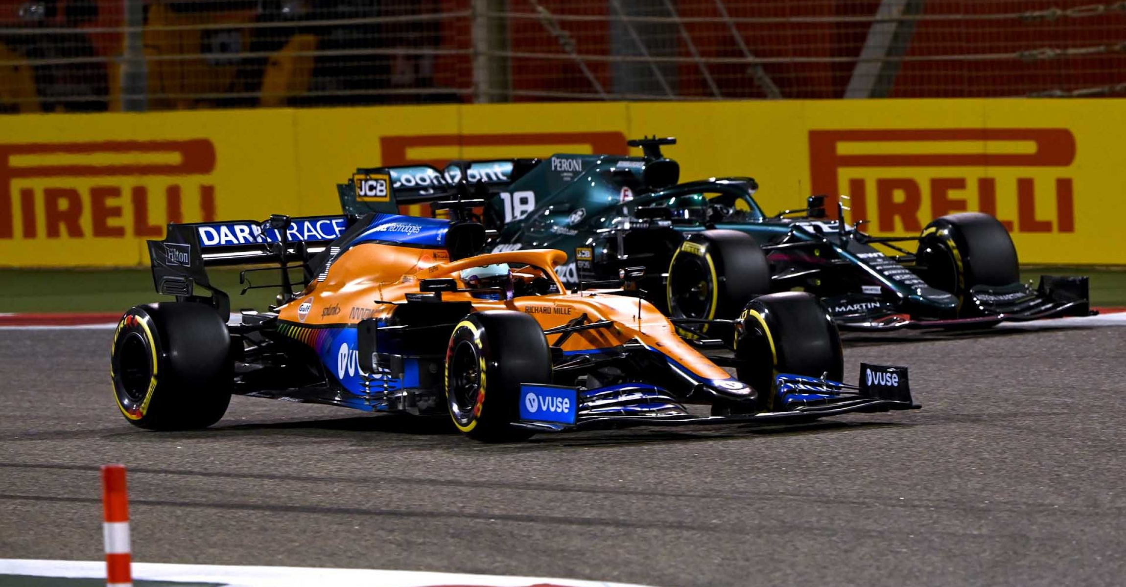 BAHRAIN INTERNATIONAL CIRCUIT, BAHRAIN - MARCH 28: Daniel Ricciardo, McLaren MCL35M, battles with Lance Stroll, Aston Martin AMR21 during the Bahrain GP at Bahrain International Circuit on Sunday March 28, 2021 in Sakhir, Bahrain. (Photo by Mark Sutton / LAT Images)
