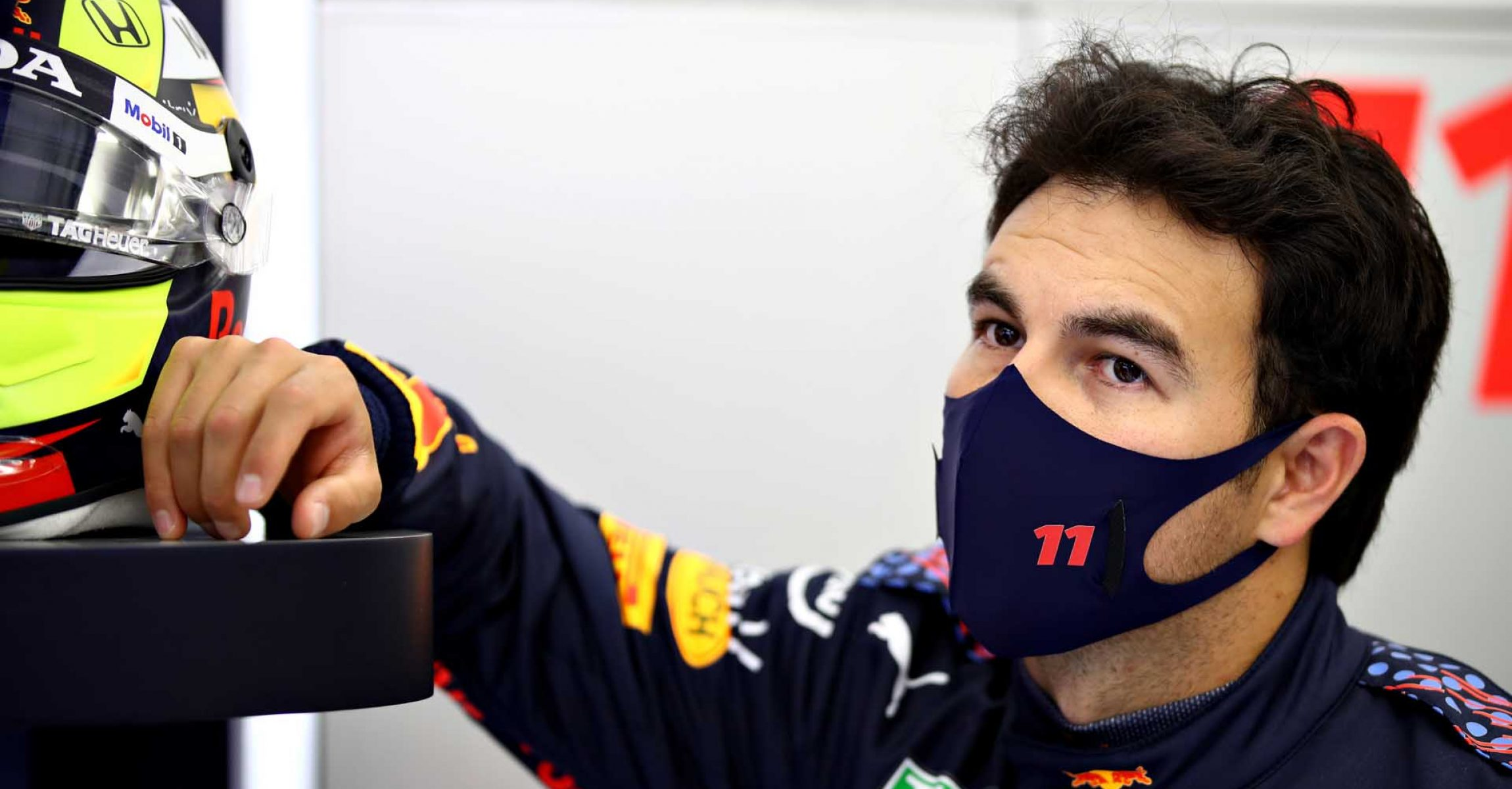 BAHRAIN, BAHRAIN - MARCH 11: Sergio Perez of Mexico and Red Bull Racing looks on in the garage during previews ahead of Formula 1 Testing at Bahrain International Circuit on March 11, 2021 in Bahrain, Bahrain. (Photo by Mark Thompson/Getty Images)