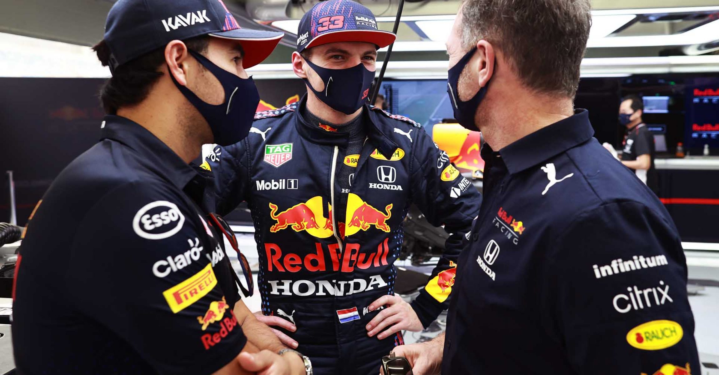 BAHRAIN, BAHRAIN - MARCH 12: Max Verstappen of Netherlands and Red Bull Racing talks with Sergio Perez of Mexico and Red Bull Racing and Red Bull Racing Team Principal Christian Horner in the garage during Day One of F1 Testing at Bahrain International Circuit on March 12, 2021 in Bahrain, Bahrain. (Photo by Mark Thompson/Getty Images) // Getty Images / Red Bull Content Pool  // SI202103121078 // Usage for editorial use only //