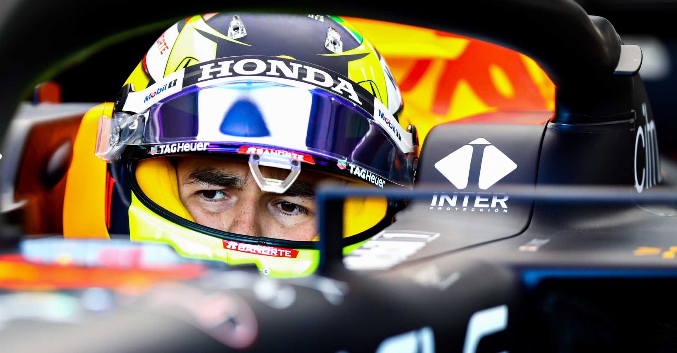 IMOLA, ITALY - APRIL 16: Sergio Perez of Mexico and Red Bull Racing prepares to drive in the garage during practice ahead of the F1 Grand Prix of Emilia Romagna at Autodromo Enzo e Dino Ferrari on April 16, 2021 in Imola, Italy. (Photo by Mark Thompson/Getty Images)