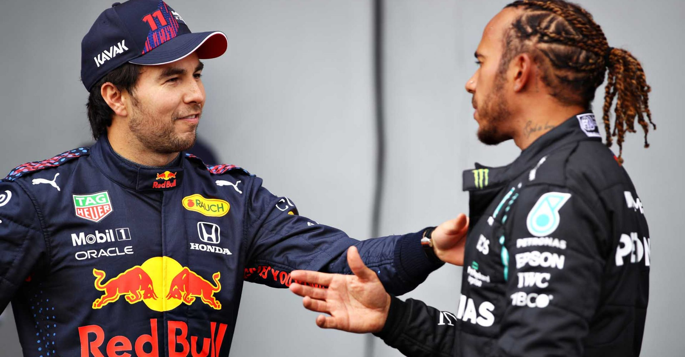 IMOLA, ITALY - APRIL 17: Second place qualifier Sergio Perez of Mexico and Red Bull Racing and pole position qualifier Lewis Hamilton of Great Britain and Mercedes GP talk in parc ferme during qualifying ahead of the F1 Grand Prix of Emilia Romagna at Autodromo Enzo e Dino Ferrari on April 17, 2021 in Imola, Italy. (Photo by Mark Thompson/Getty Images)