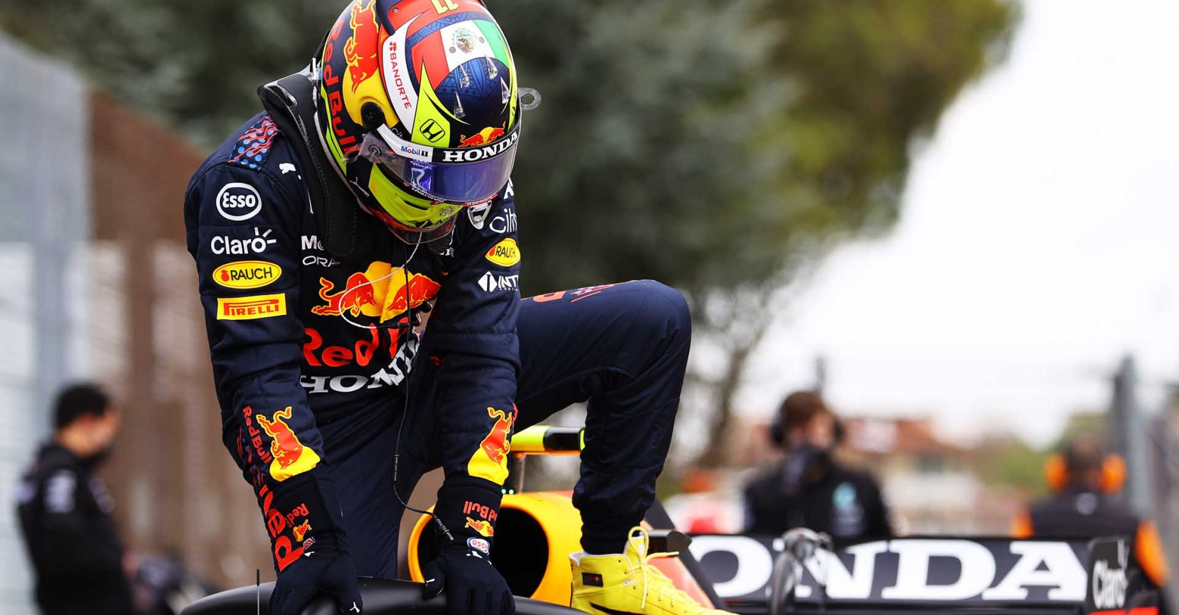 IMOLA, ITALY - APRIL 17: Second place qualifier Sergio Perez of Mexico and Red Bull Racing climbs from his car in parc ferme during qualifying ahead of the F1 Grand Prix of Emilia Romagna at Autodromo Enzo e Dino Ferrari on April 17, 2021 in Imola, Italy. (Photo by Bryn Lennon/Getty Images)