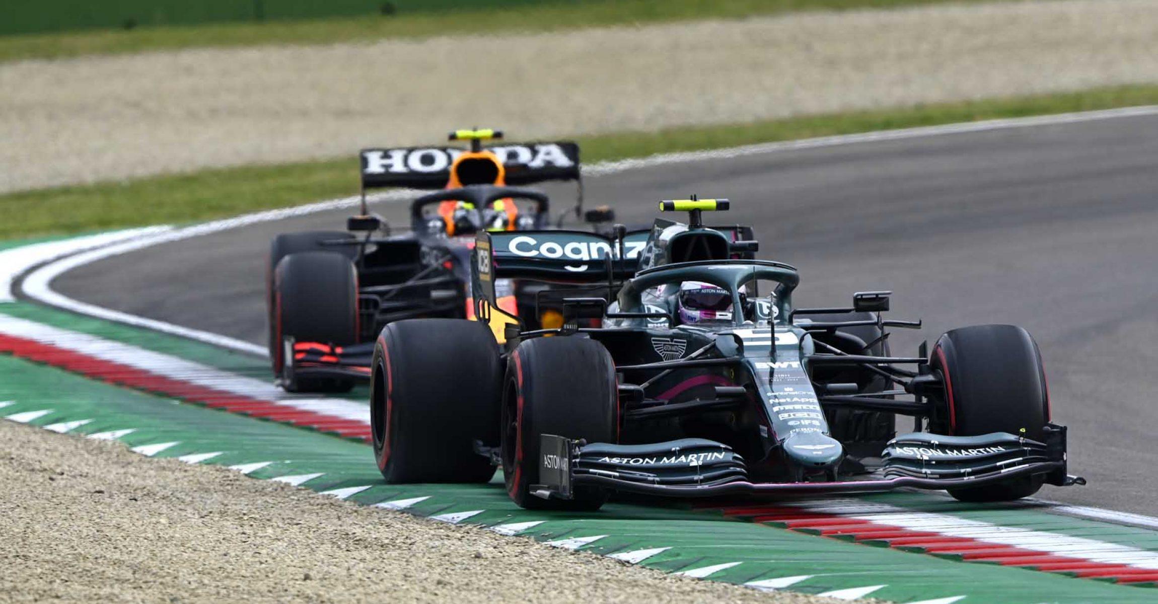 Sebastian Vettel, Aston Martin AMR21, leads Sergio Perez, Red Bull Racing RB16B