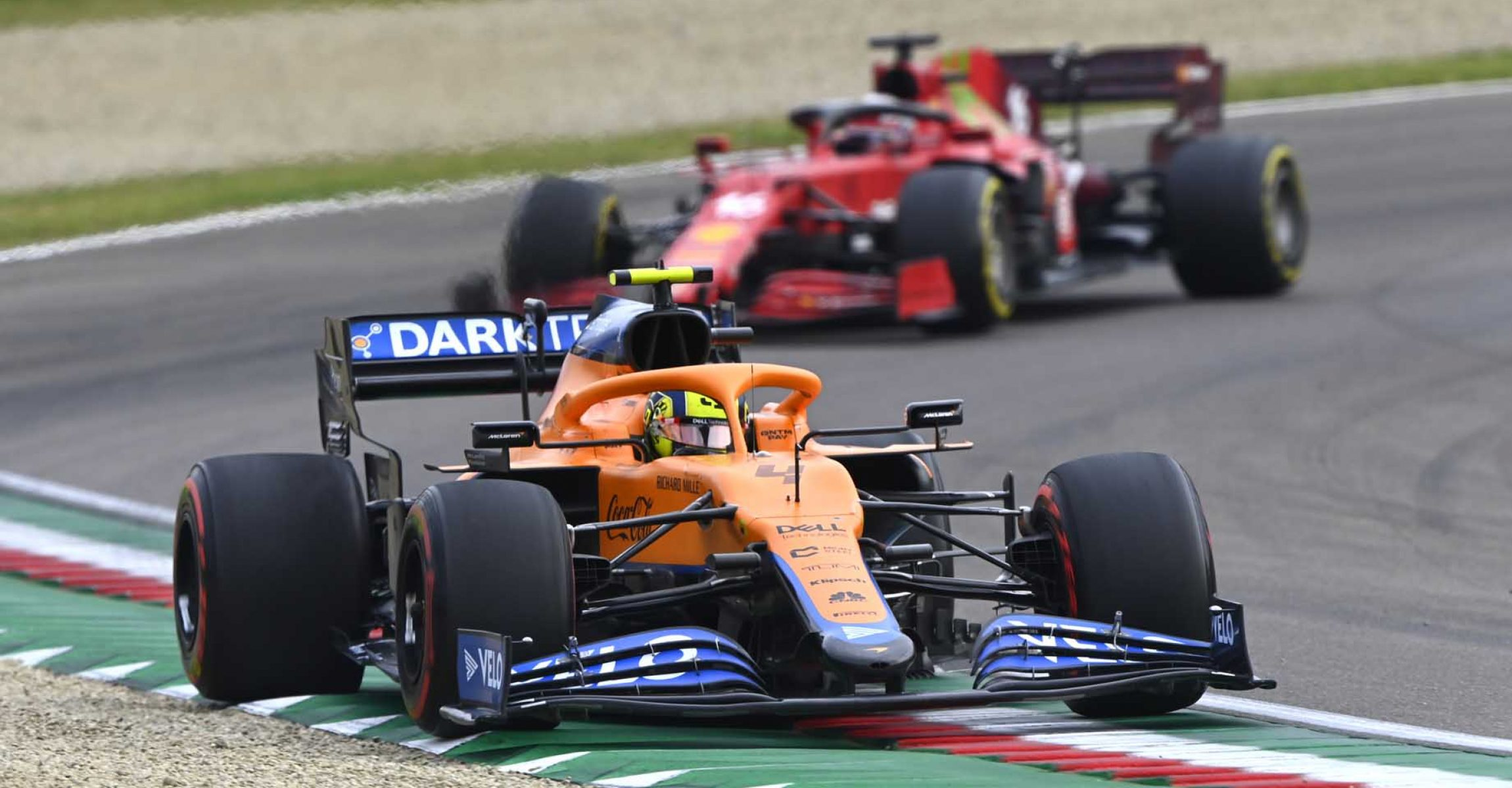 Lando Norris, McLaren MCL35M, leads Charles Leclerc, Ferrari SF21 car straight on in turn