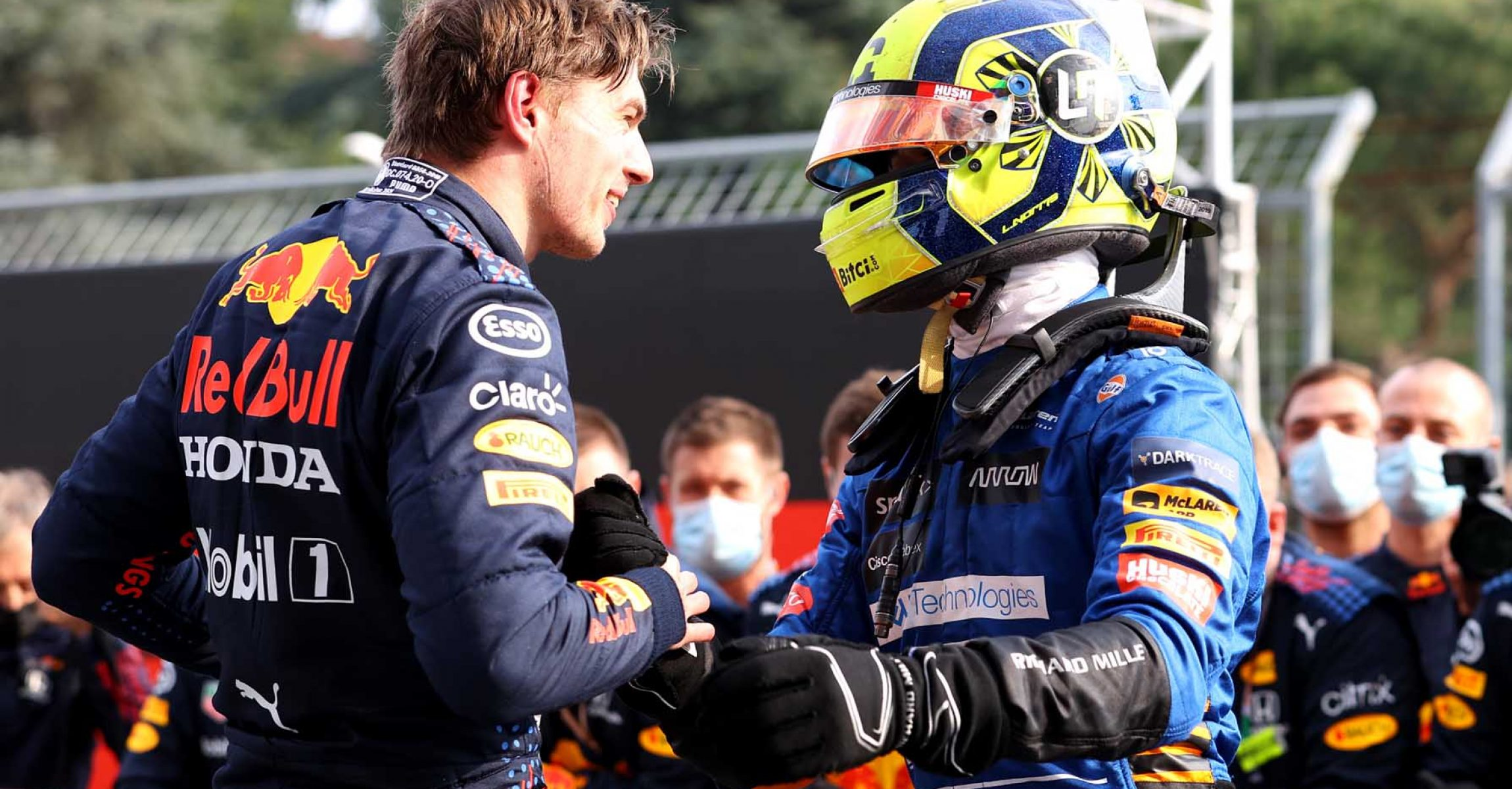 IMOLA, ITALY - APRIL 18: Race winner Max Verstappen of Netherlands and Red Bull Racing and third placed Lando Norris of Great Britain and McLaren F1 celebrate in parc ferme during the F1 Grand Prix of Emilia Romagna at Autodromo Enzo e Dino Ferrari on April 18, 2021 in Imola, Italy. (Photo by Bryn Lennon/Getty Images)