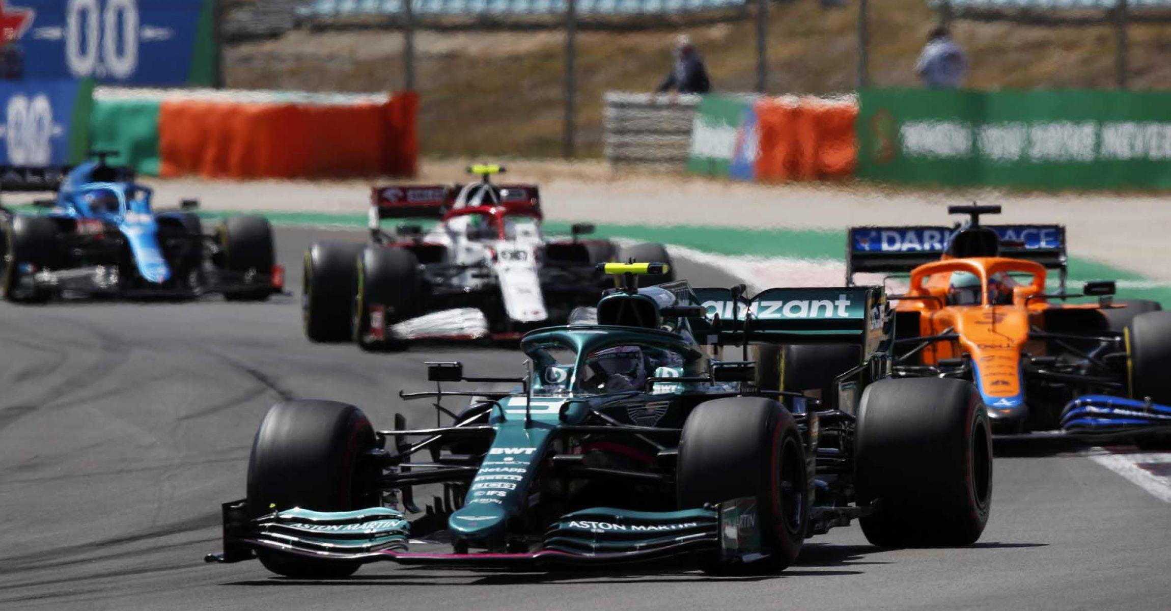 Sebastian Vettel, Aston Martin AMR21, leads Daniel Ricciardo, McLaren MCL35M, Antonio Giovinazzi, Alfa Romeo Racing C41, and Fernando Alonso, Alpine A521