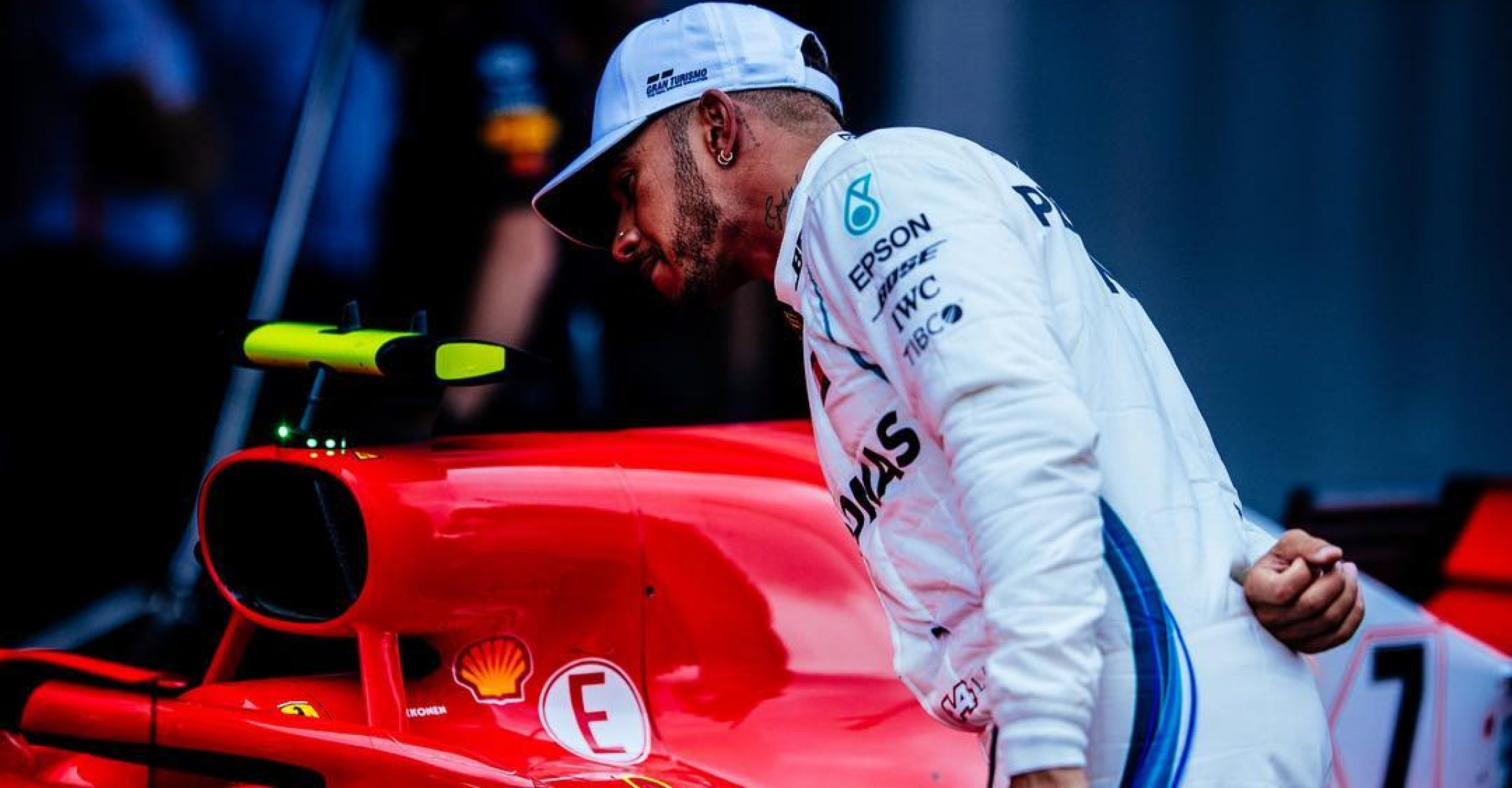Lewis Hamilton (Mercedes) checks Ferrari's car at the end of the qualifying session during the Spanish Grand Prix in Barcelona (2018)