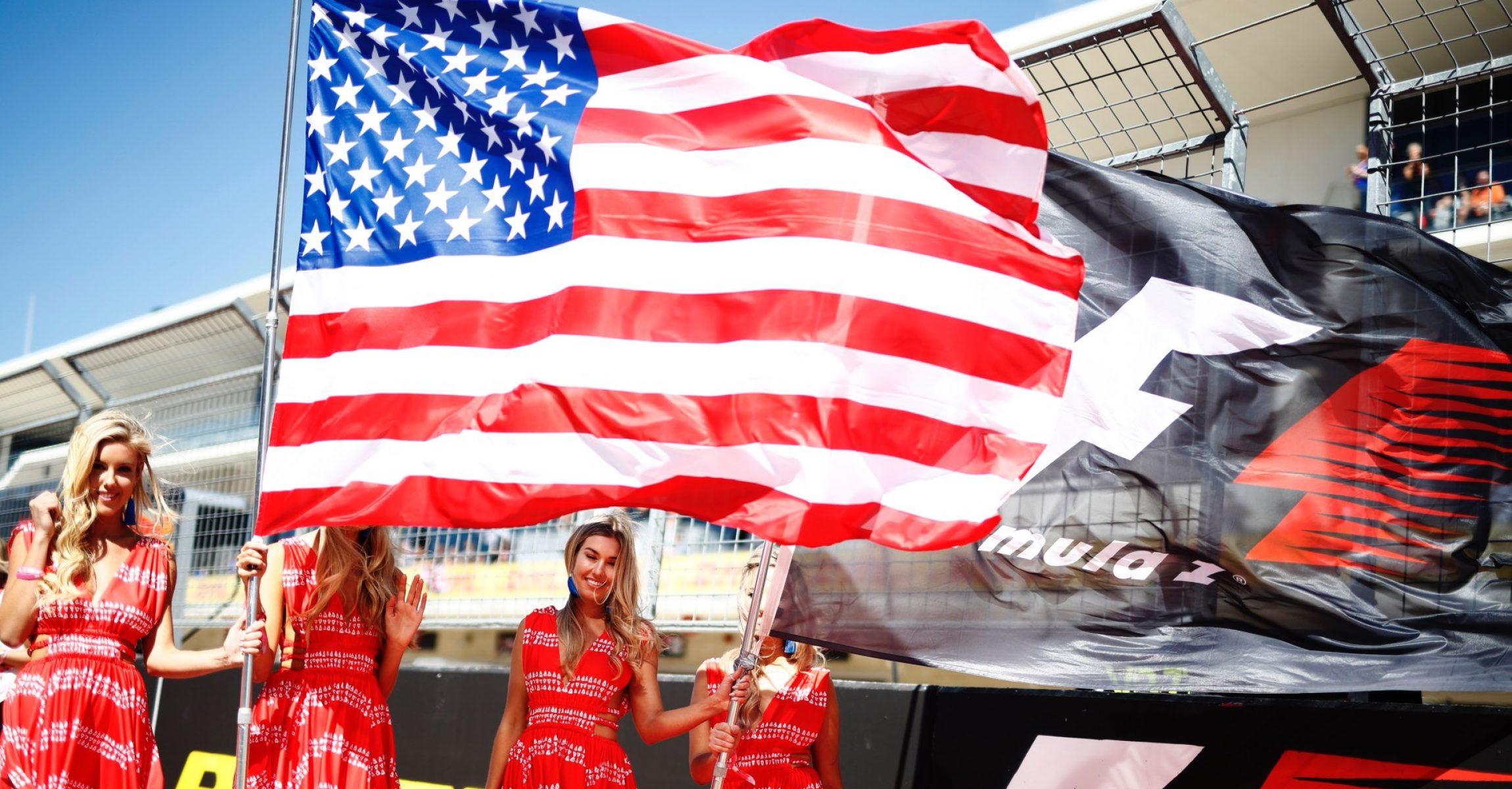 Circuit of the Americas, Austin, Texas, United States of America. Sunday 22 October 2017. World Copyright: Glenn Dunbar/LAT Images  ref: Digital Image _X4I4933, grid girls, America, flag USAGP2017