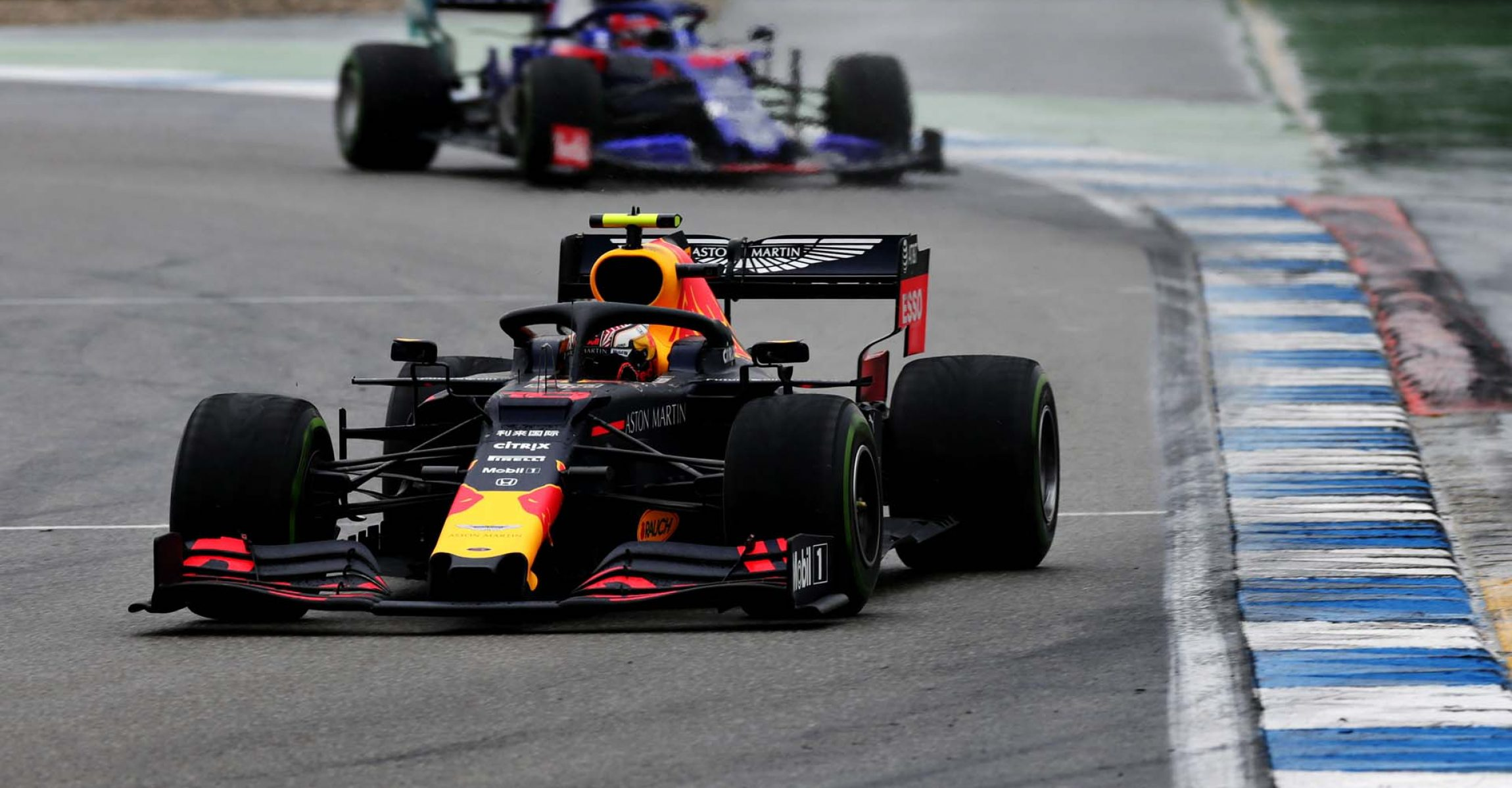 HOCKENHEIM, GERMANY - JULY 28: Pierre Gasly of France driving the (10) Aston Martin Red Bull Racing RB15 leads Daniil Kvyat driving the (26) Scuderia Toro Rosso STR14 Honda on track during the F1 Grand Prix of Germany at Hockenheimring on July 28, 2019 in Hockenheim, Germany. (Photo by Peter Fox/Getty Images) // Getty Images / Red Bull Content Pool  // AP-2139Q439H2111 // Usage for editorial use only // Please go to www.redbullcontentpool.com for further information. //