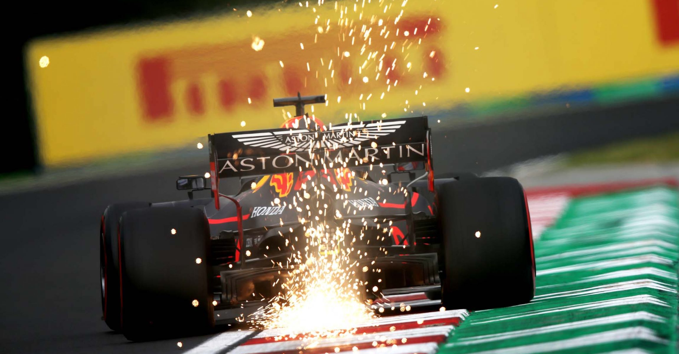 BUDAPEST, HUNGARY - AUGUST 02: Sparks fly behind Max Verstappen of the Netherlands driving the (33) Aston Martin Red Bull Racing RB15 on track during practice for the F1 Grand Prix of Hungary at Hungaroring on August 02, 2019 in Budapest, Hungary. (Photo by Charles Coates/Getty Images) // Getty Images / Red Bull Content Pool // AP-214VKTWXS1W11 // Usage for editorial use only // Please go to www.redbullcontentpool.com for further information. //