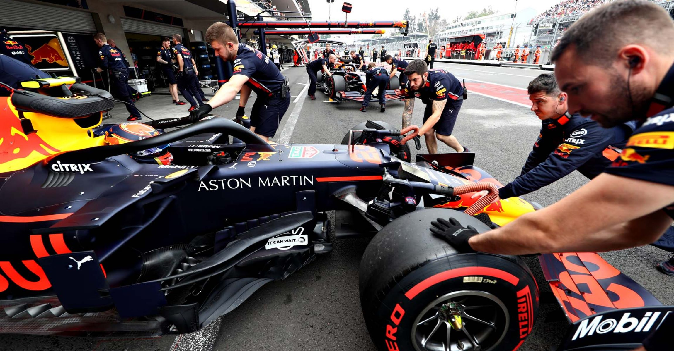 MEXICO CITY, MEXICO - OCTOBER 26: Alexander Albon of Thailand driving the (23) Aston Martin Red Bull Racing RB15 is pushed back into the garage during qualifying for the F1 Grand Prix of Mexico at Autodromo Hermanos Rodriguez on October 26, 2019 in Mexico City, Mexico. (Photo by Mark Thompson/Getty Images) // Getty Images / Red Bull Content Pool // AP-21ZBUTKZS2111 // Usage for editorial use only //